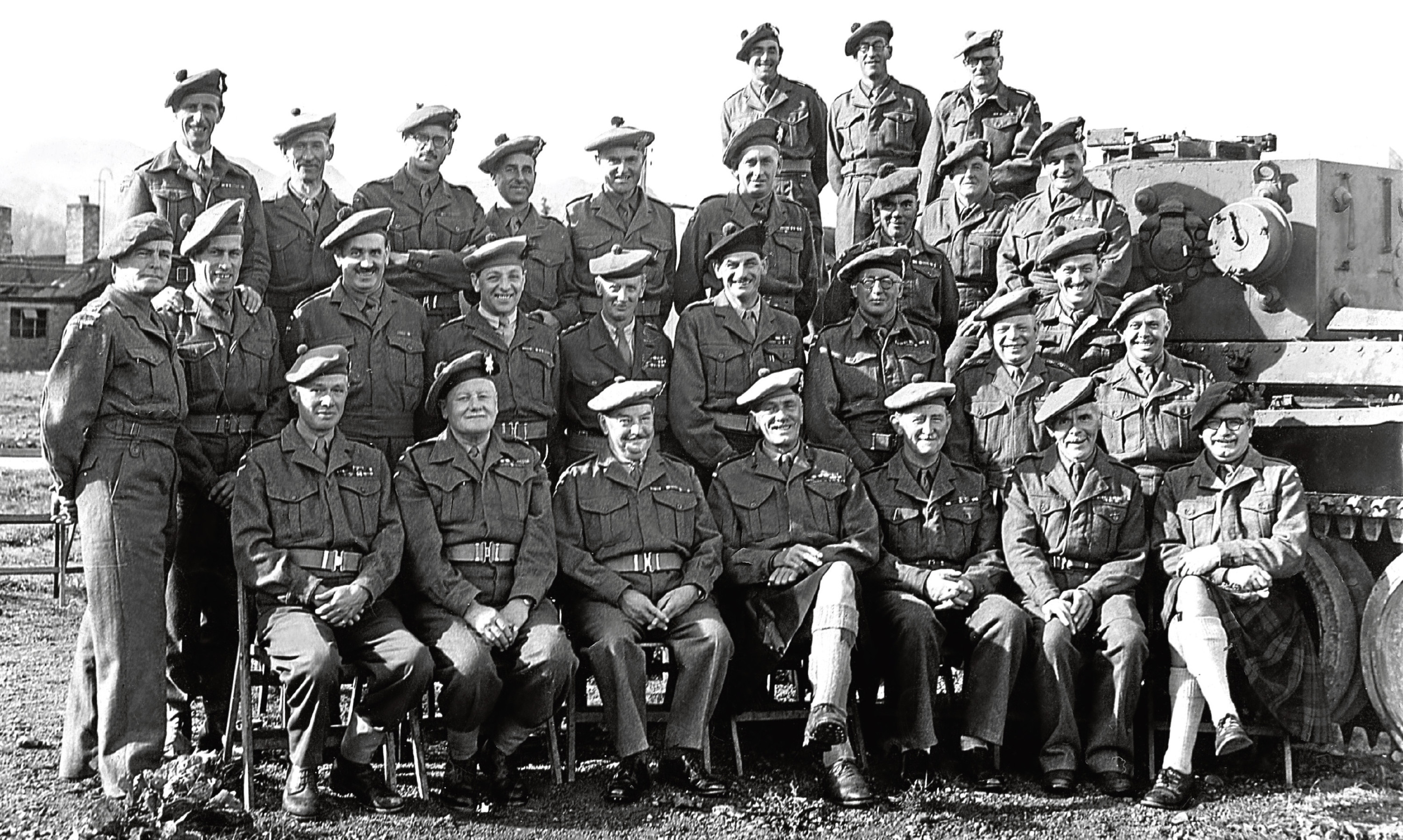 Angus Whitson's father Tom, bottom right, front row, in what became his familiar form of dress - a kilt.