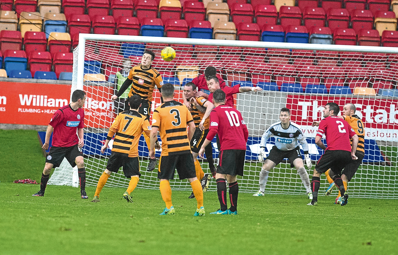 Alloa's Jason Marr scores the winning goal.