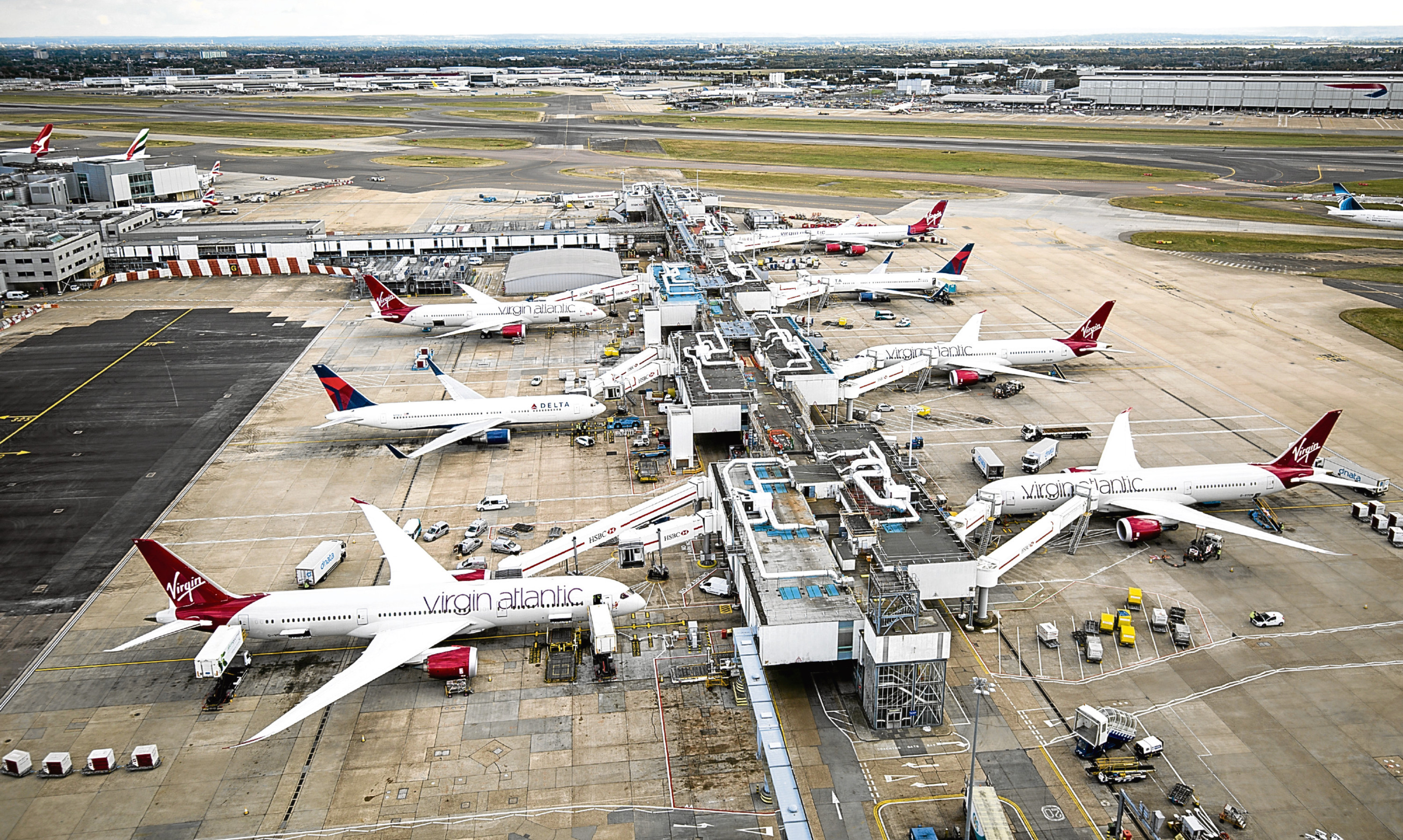 Aircraft wait on stands at Hathrow's Terminal 3