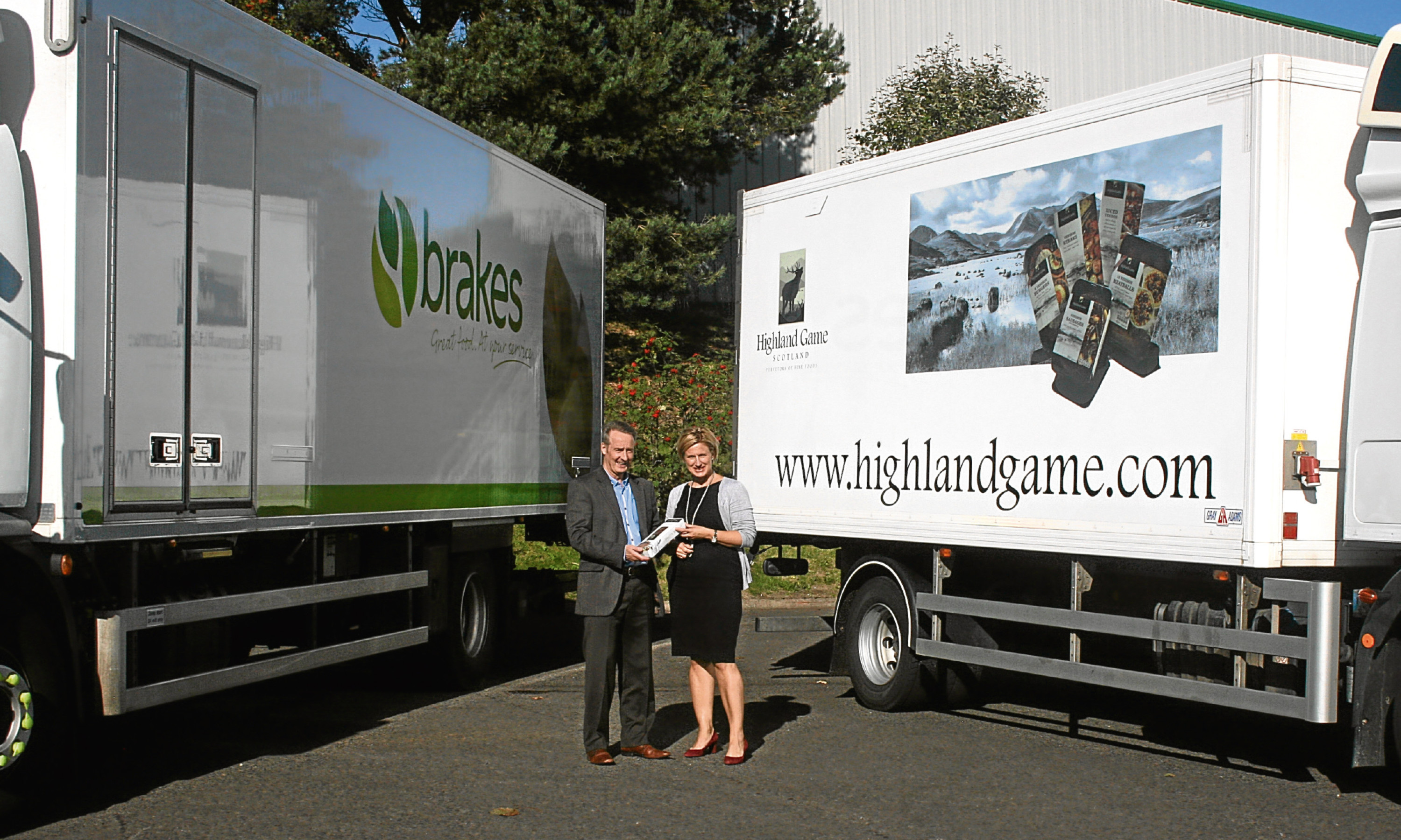 John McLintock of Brakes Scotland and Highland Games Ingela Nissen seal the new supply deal.