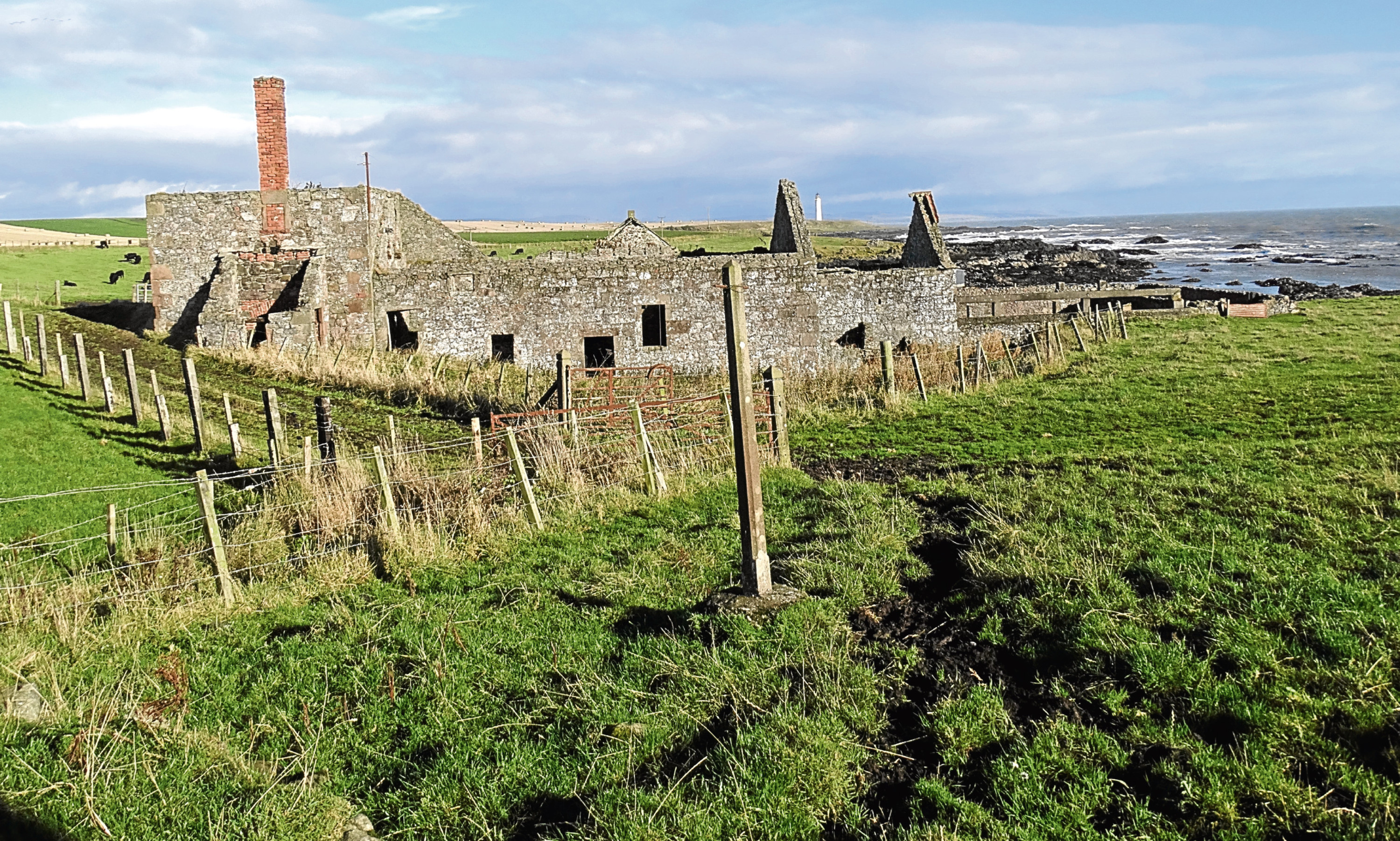 The old flax mill at Usan Farm with Scurdieness Lighthouse in the background.