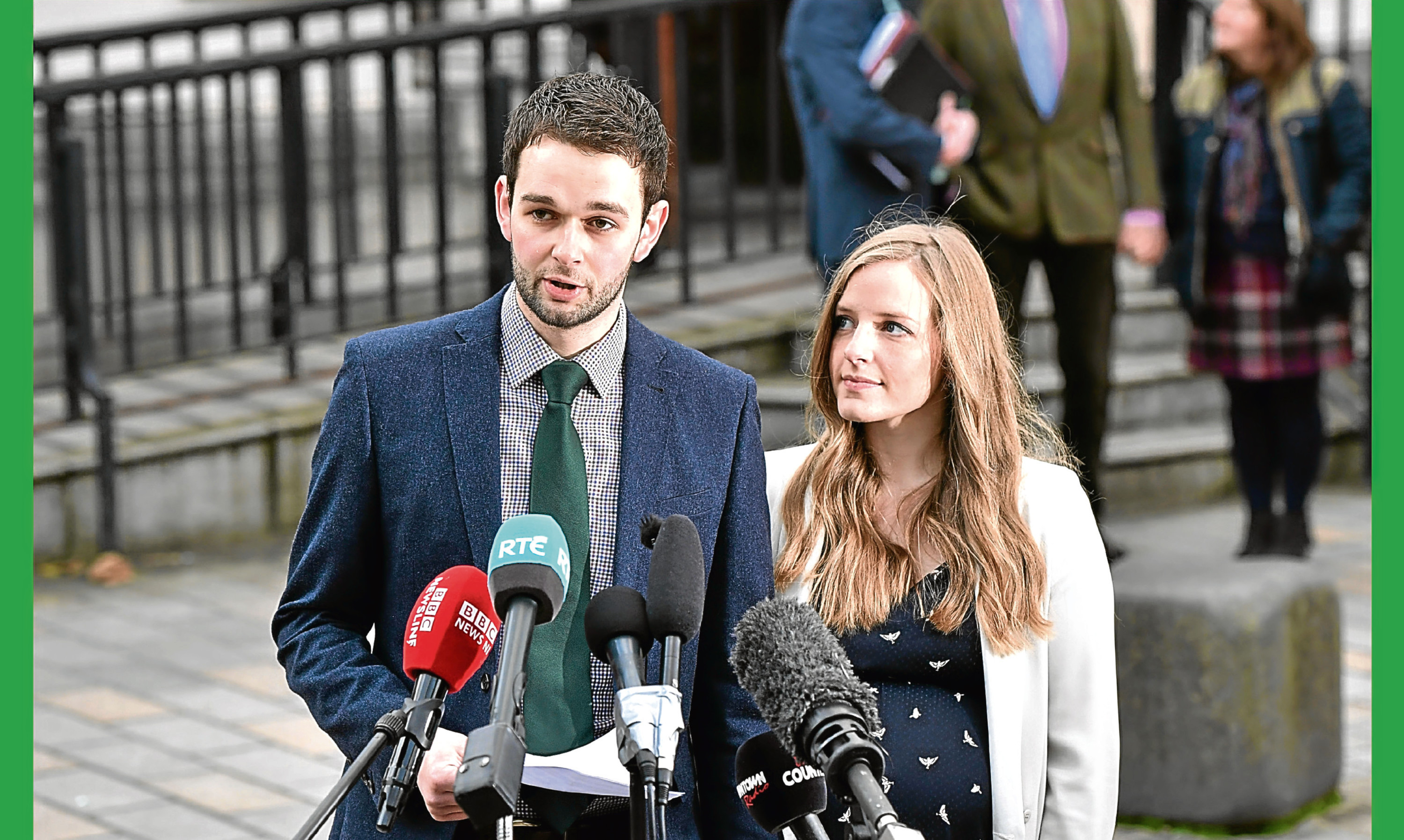 Daniel McArthur, managing director of Ashers Bakery and his wife Amy McArthur speak outside Belfast high court.