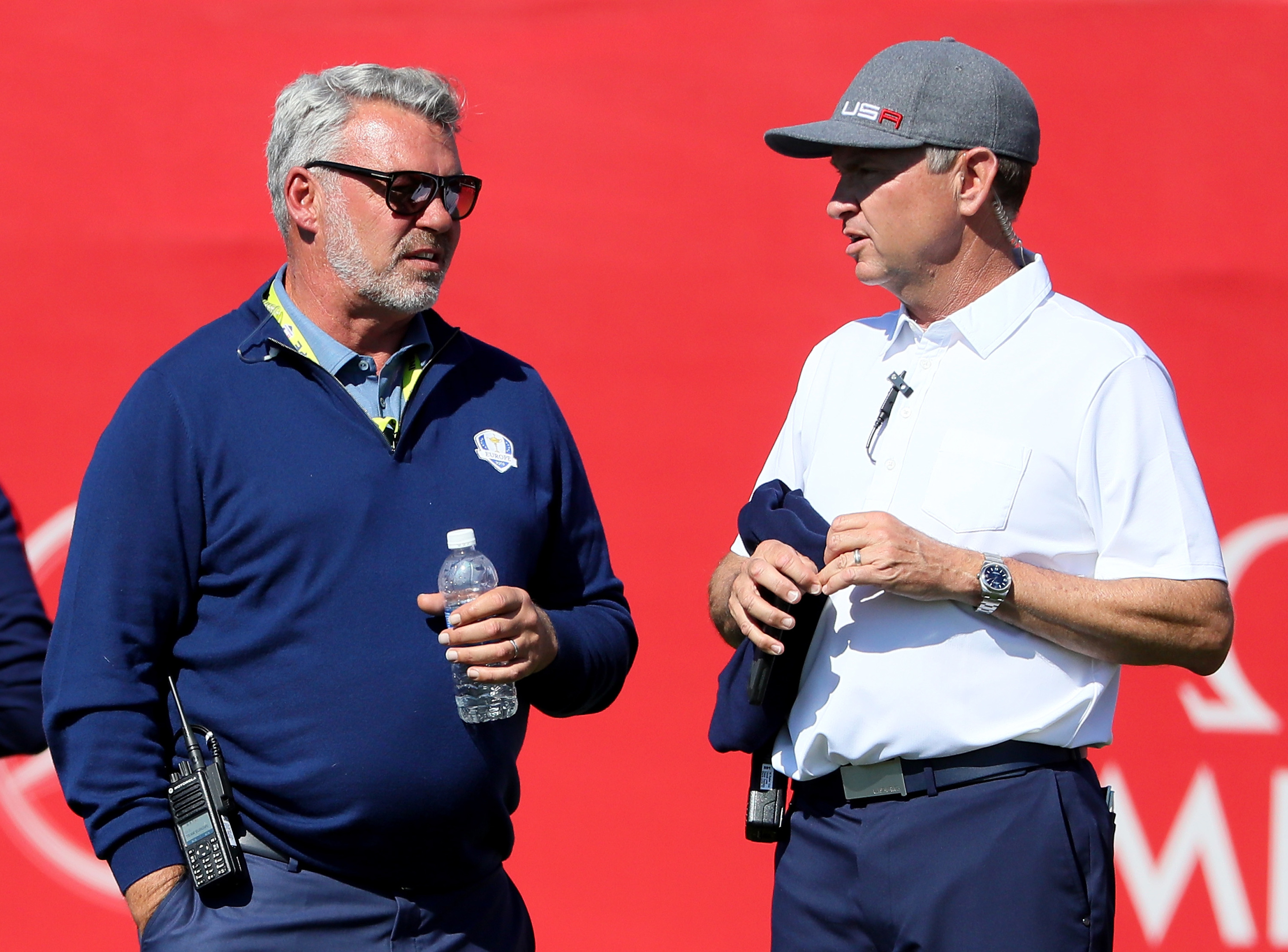 Darren Clarke and Davis Love III suffered through a fluctuating first day at Hazeltine.