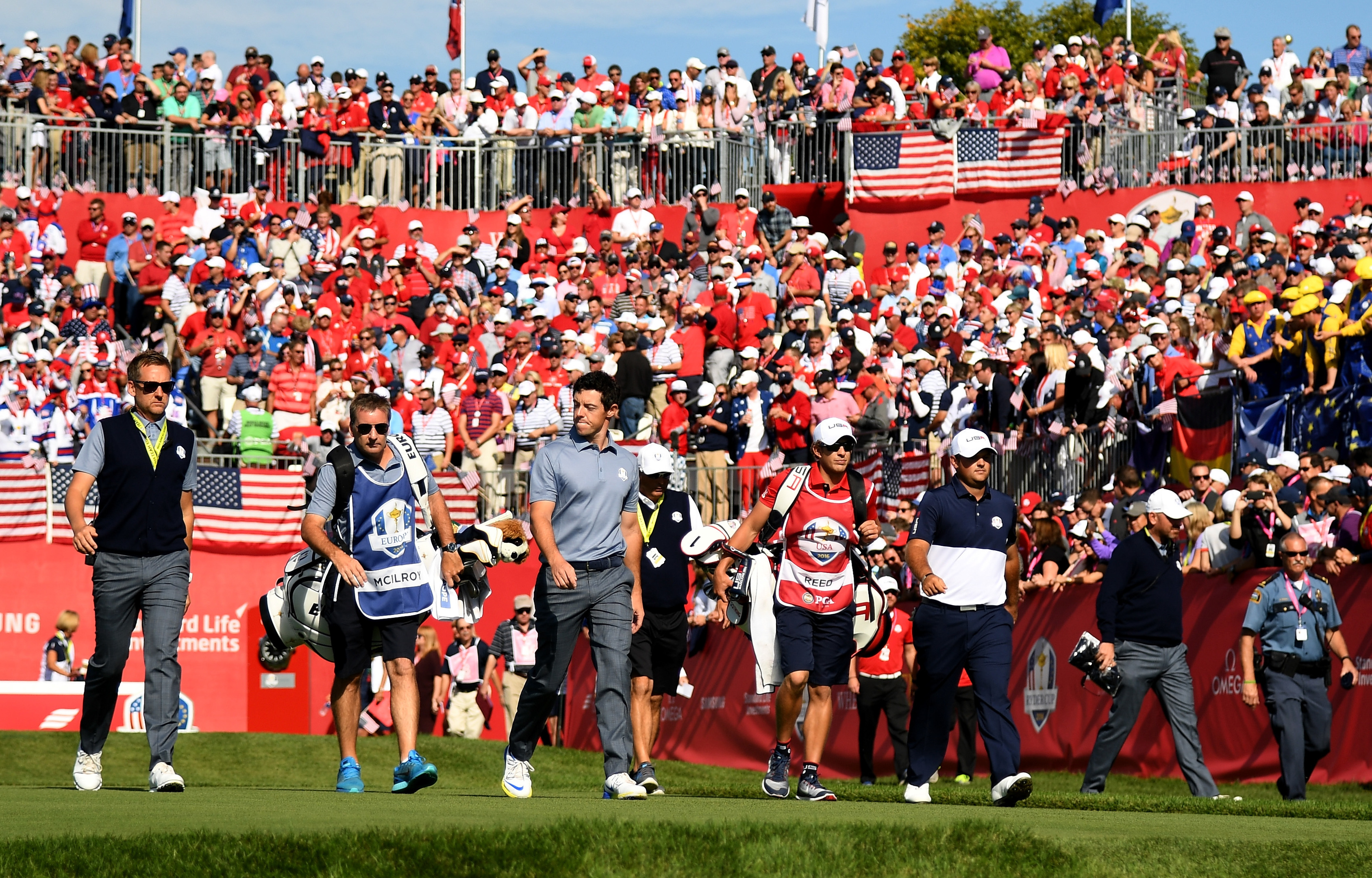Rory McIlroy and Patrick Reed leavce the first tee, one of the few areas at Hazeltine that was noisy but respectful all weekend.