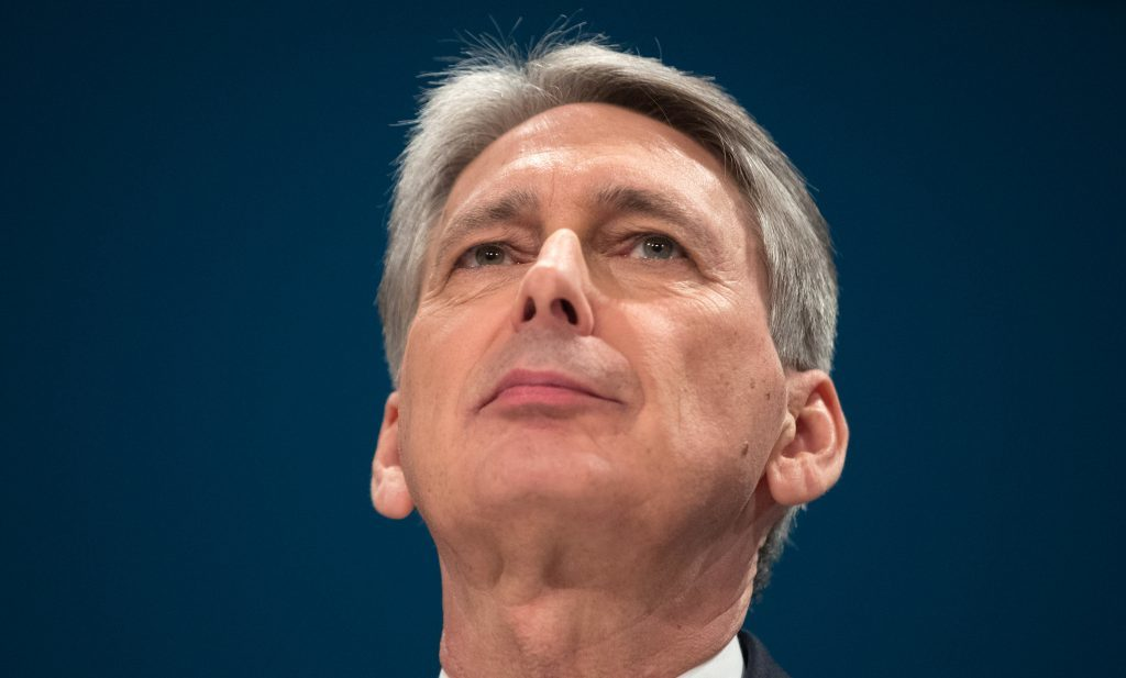 Philip Hammond delivers a speech on the economy during the second day of the Conservative Party Conference in Birmingham.
