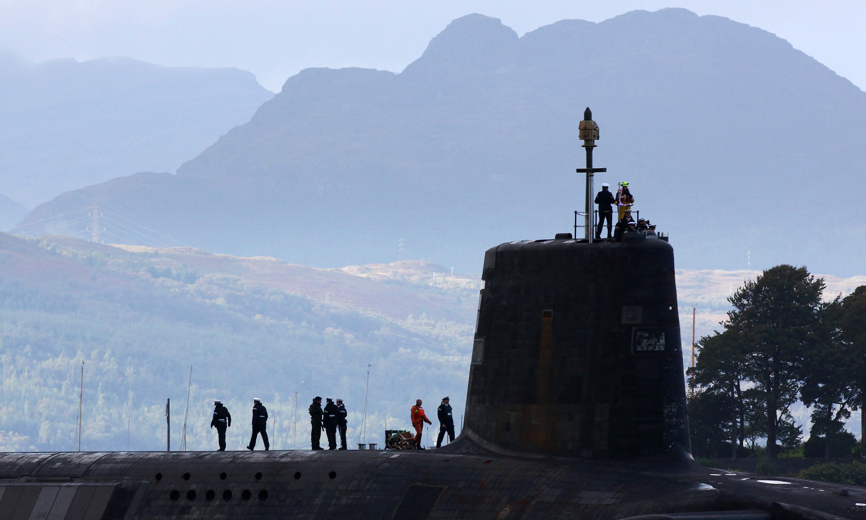 A trident submarine makes it's way out from Faslane Naval base.