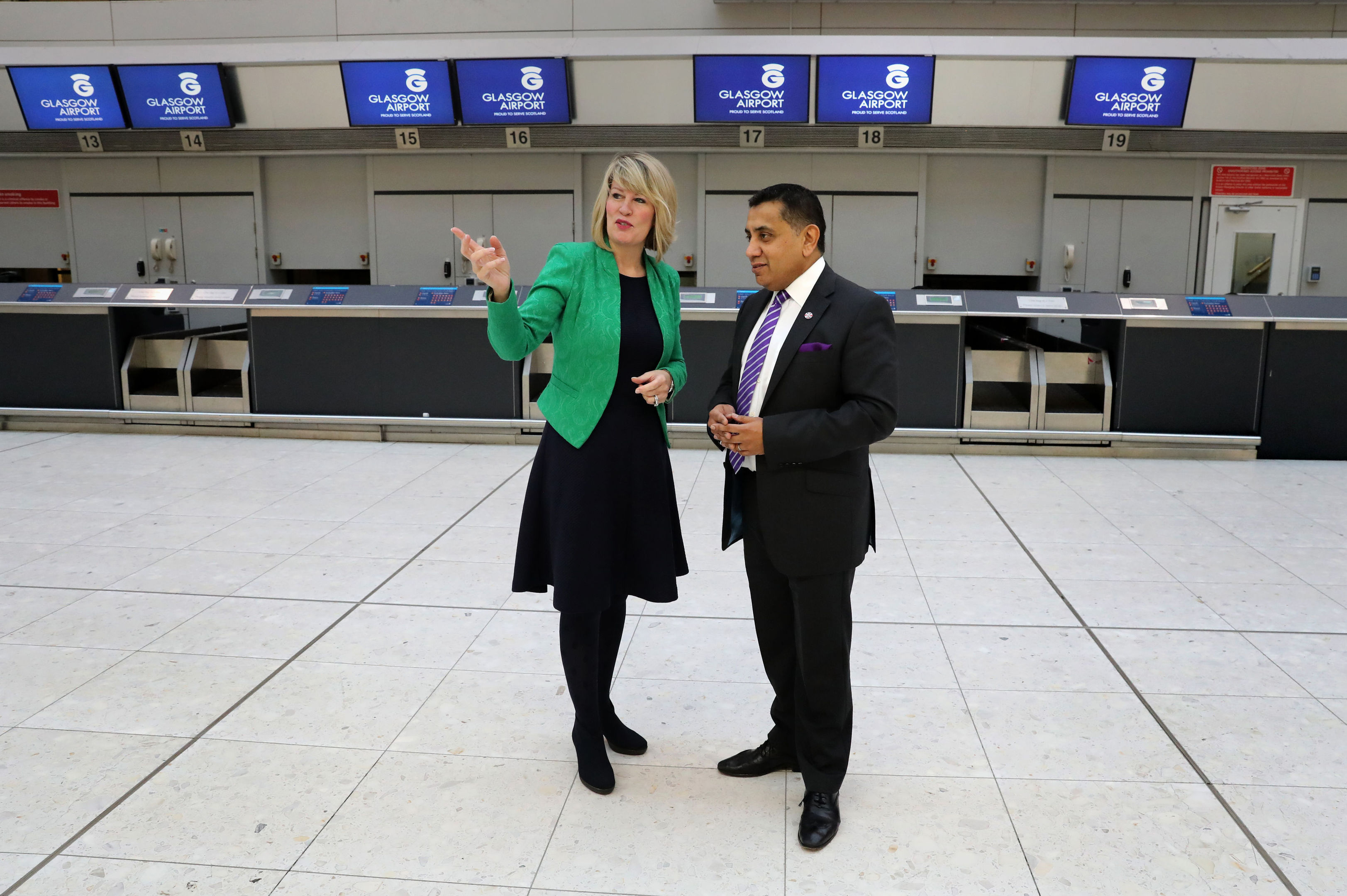 Lord Ahmad during a visit to Glasgow Airport where he met airport chief executive Amanda McMillan.
