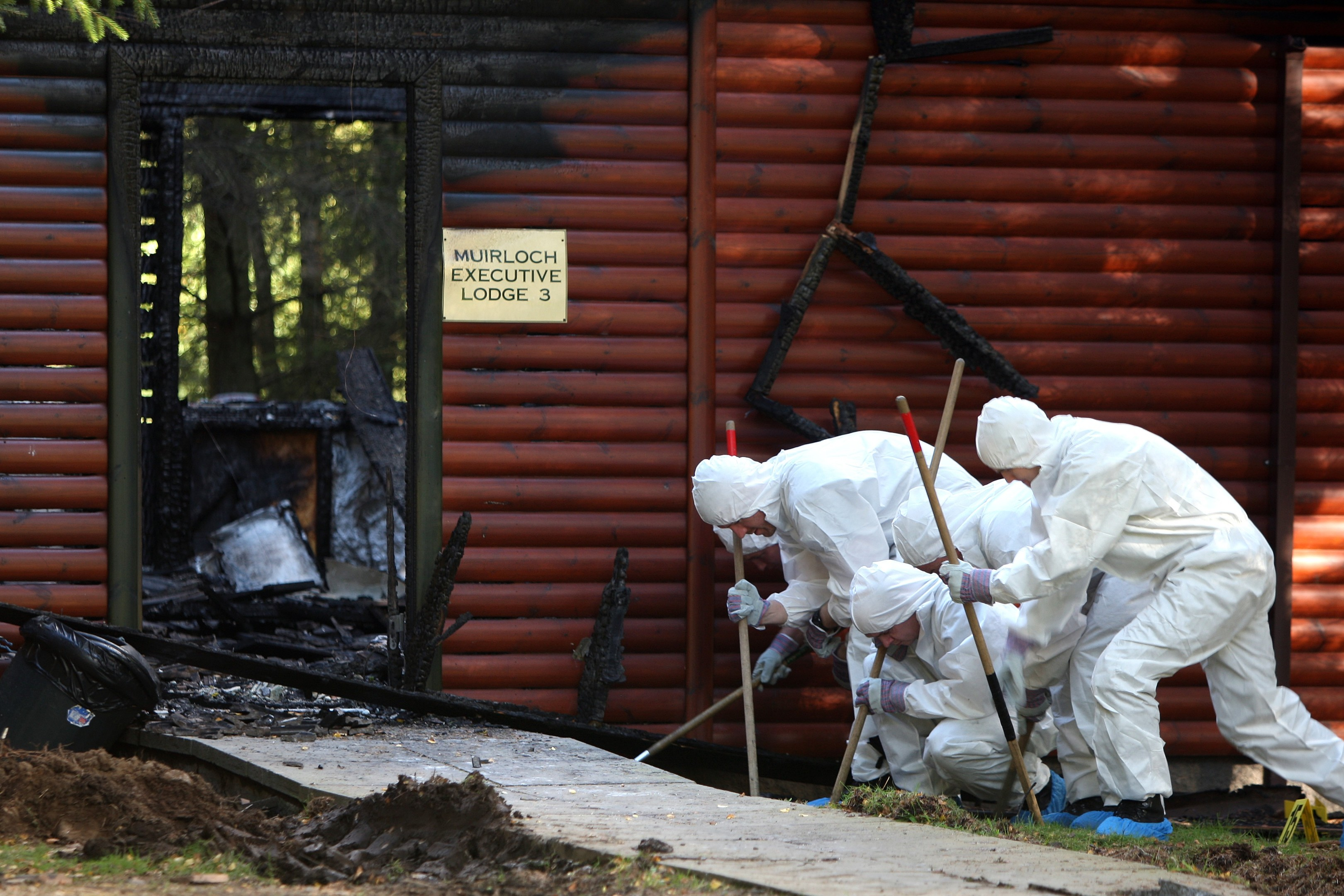 Police carry out a forensic examination of the lodge in 2015.
