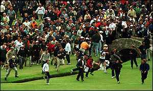 Crowds break through the barriers and stampede down the fairway as Tiger Mania grips the final hole of the 2000 Open at St Andrews
