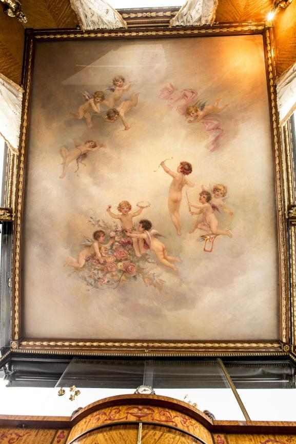 The ceiling is painted with cherubs.