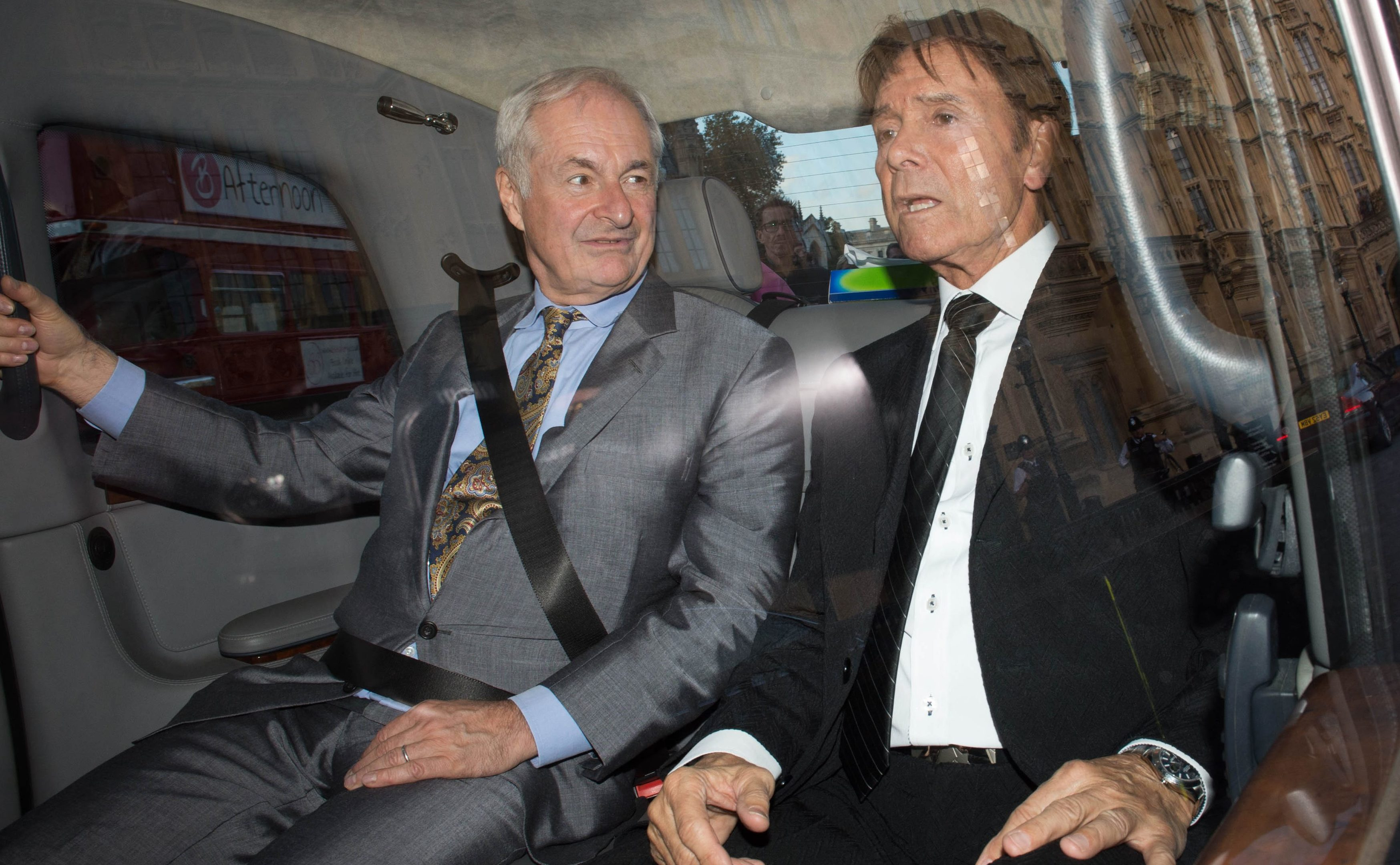 Paul Gambaccini and Sir Cliff Richard  leave the Palace of Westminster in central London, after meeting MPs and Peers to warn them of the impact of being wrongly accused of sex crimes.