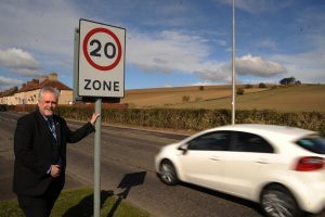 Bill Brown at the 20 MPH sign in Kinglassie (c) David Wardle