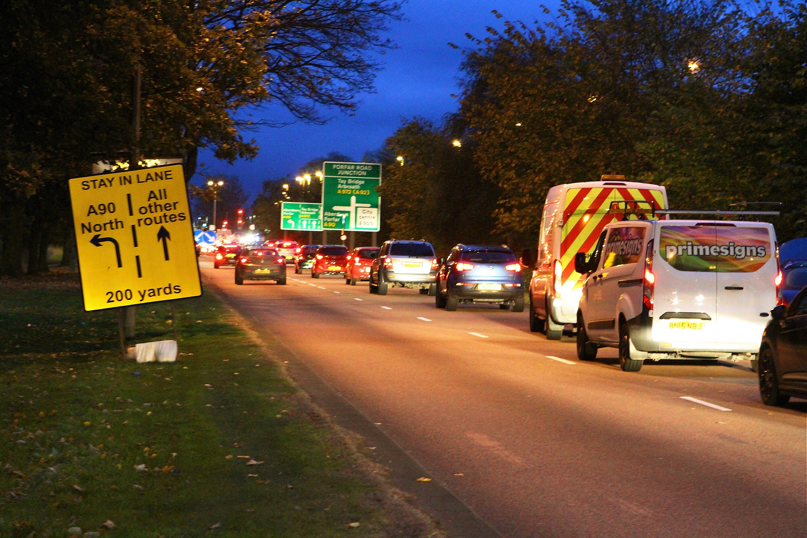 Traffic queuing on the eastbound carriageway of the Kingsway near the traffic lights at Forfar Road.