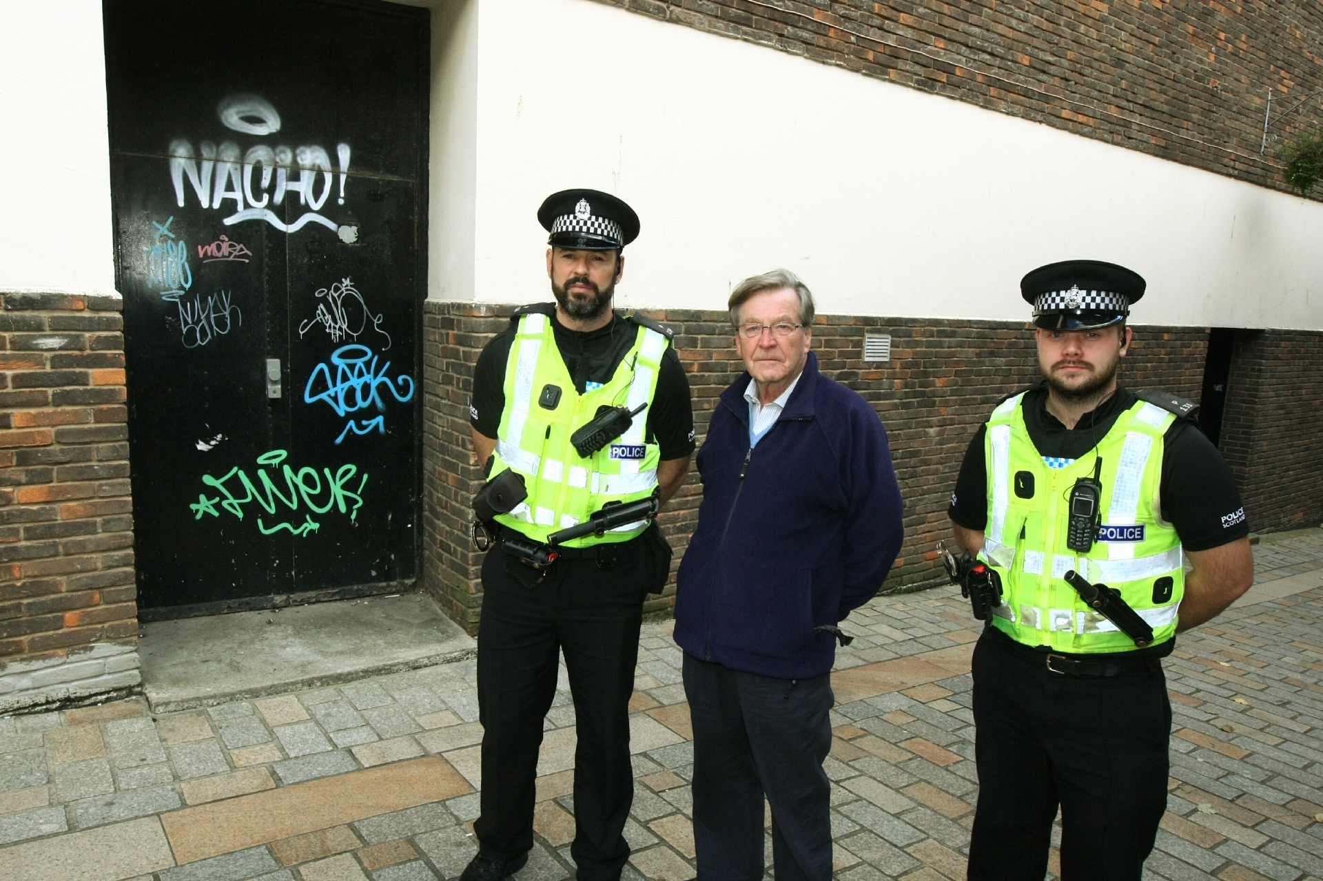L-R: Constable Mark McCulloch, David Henderson - Chairman of Kirkcaldy West Community Council and Constable Cameron Lee beside some of the graffiti in Bell Inn Wynd, Kirkcaldy.