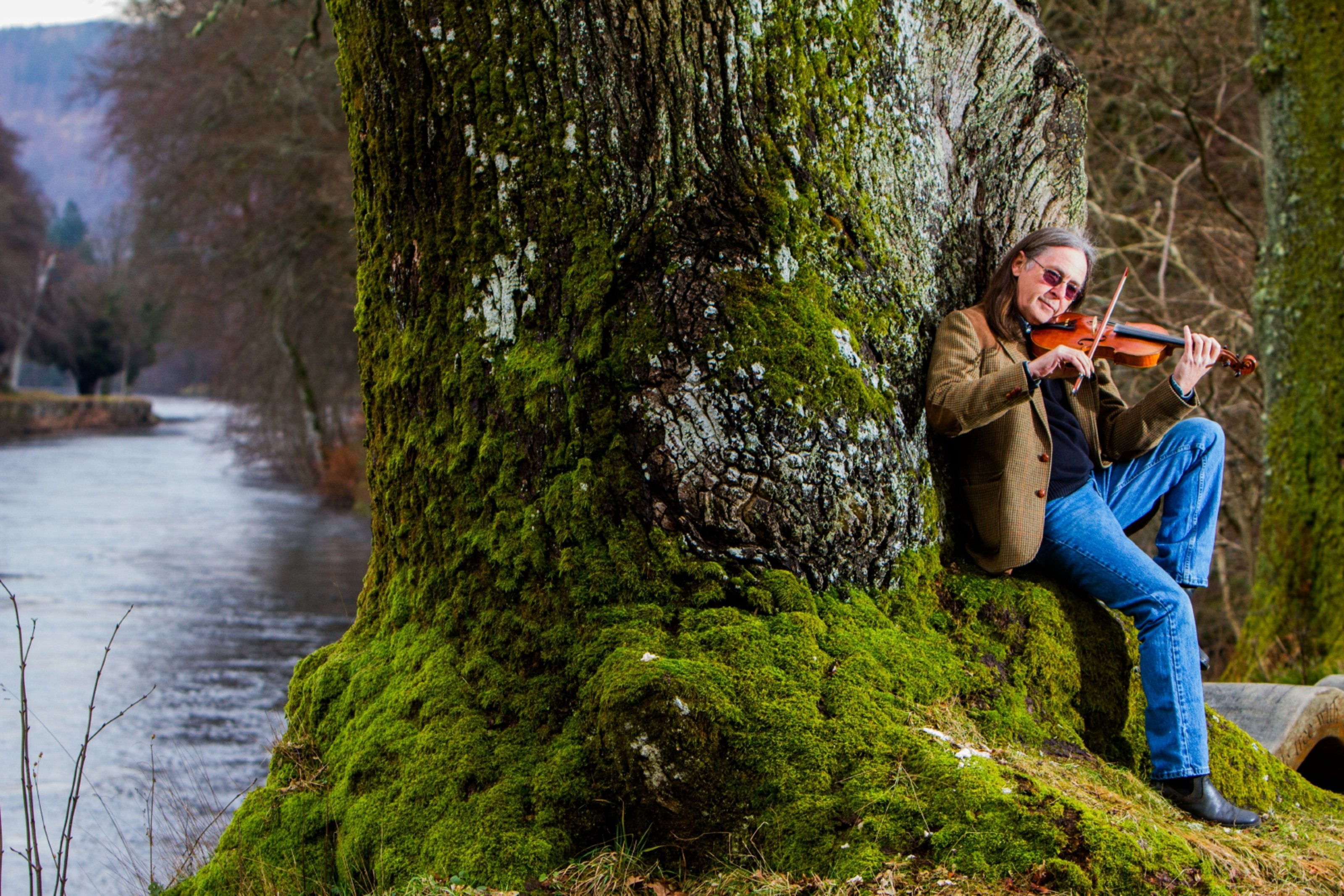 Scottish musician Dougie MacLean under the Niel Gow oak near Dunkeld. Dougie is one of many modern day admirers of Gow's work.