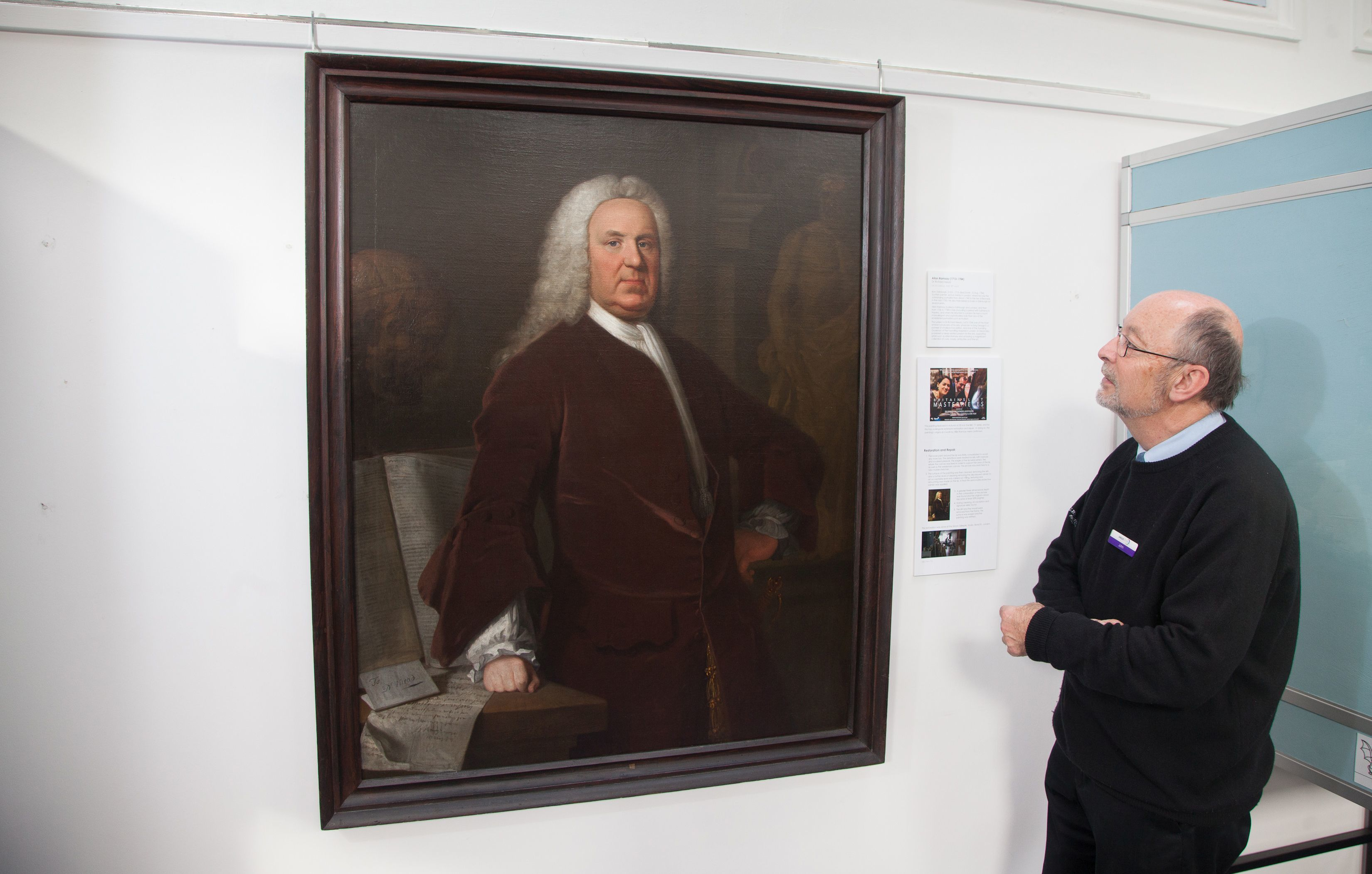 Scottish painter Allan Ramsay's portrait of Dr Richard Mead is examined by at ANGUSalive's collections officer John Johnston at Montrose Museum.