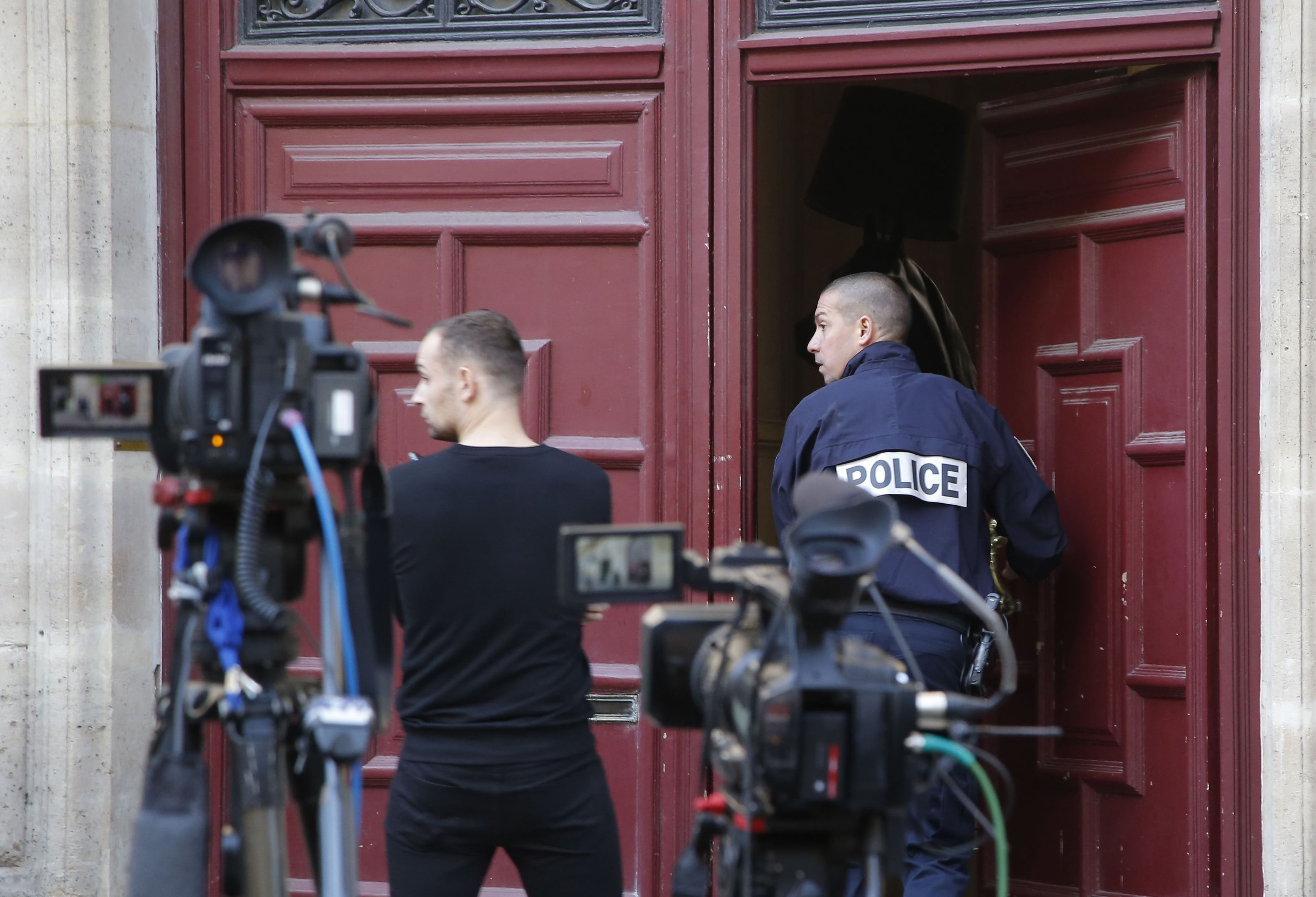 A French police officer enters the residence of Kim Kardashian West in Paris.