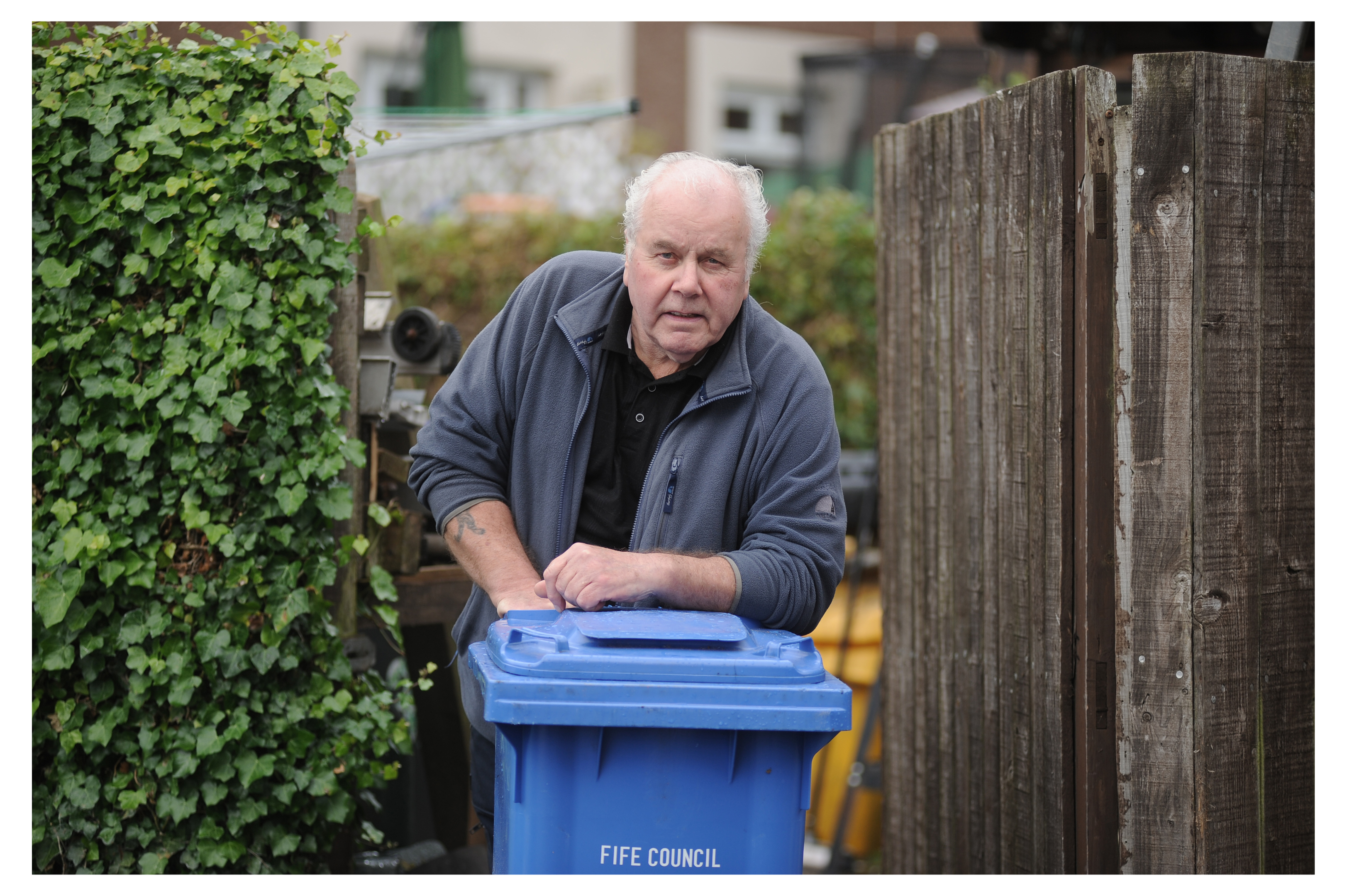 "Colin Cookson who is complaining that blue ""skinny"" bins are not large enough for a four-weekly bin collection."