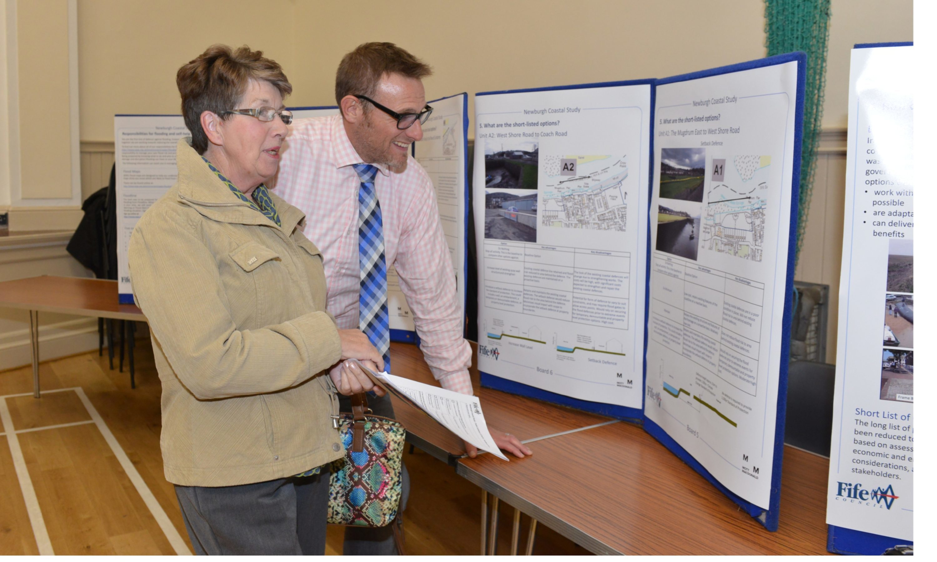 Senior coastal engineer Nick Bean, of Mott MacDonald, explains the options to Roslyn Kennedy