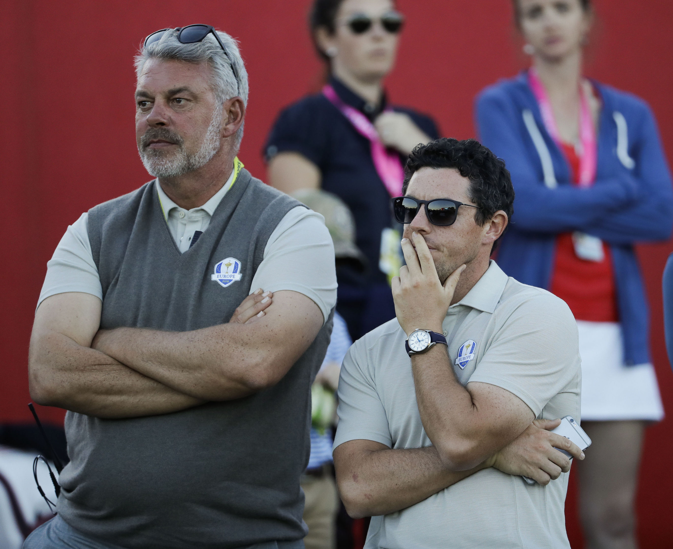 Europe captain Darren Clarke and Europe's Rory McIlroy watch as Europe's chances fade on Saturday night at Hazeltine.