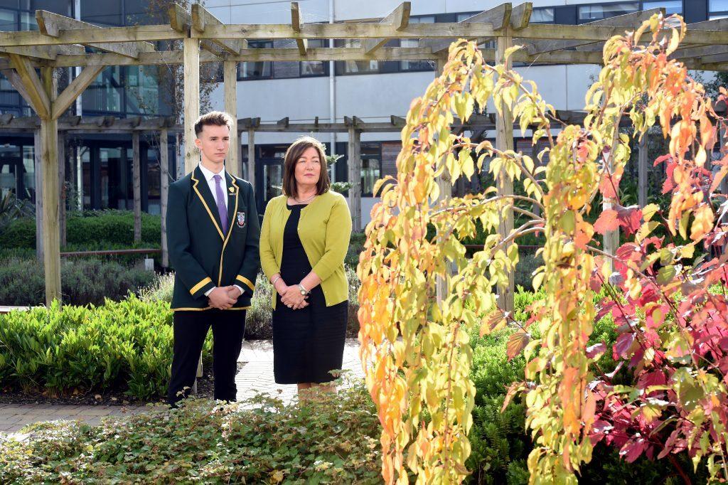 Cults Academy Head Teacher, Anna Muirhead and Head Boy, Luke Morrice, at the Bailey Gwynne memorial tree in the courtyard of the school.
