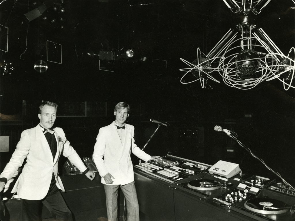 """DJs showing off the new lighting system at """"Night Magic"""" in 1983."""