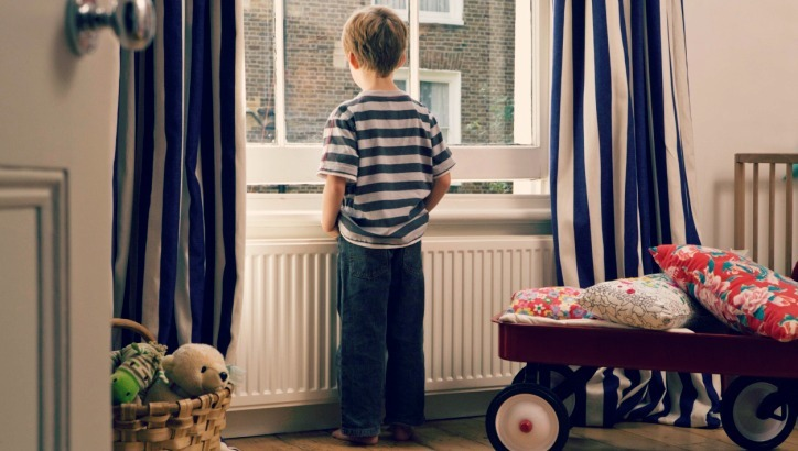Stock image of a child home alone