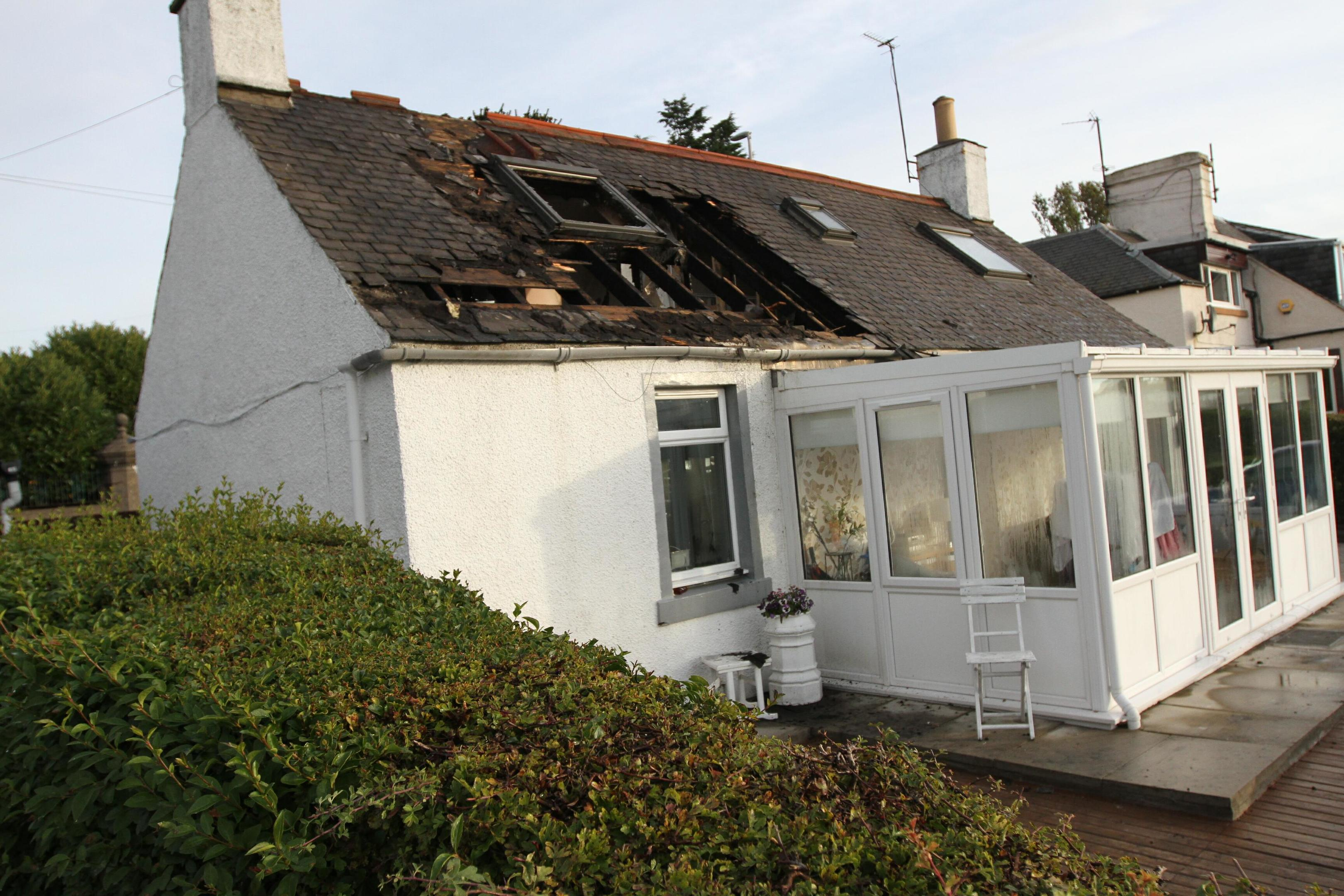 The house sustained damage to its roof.