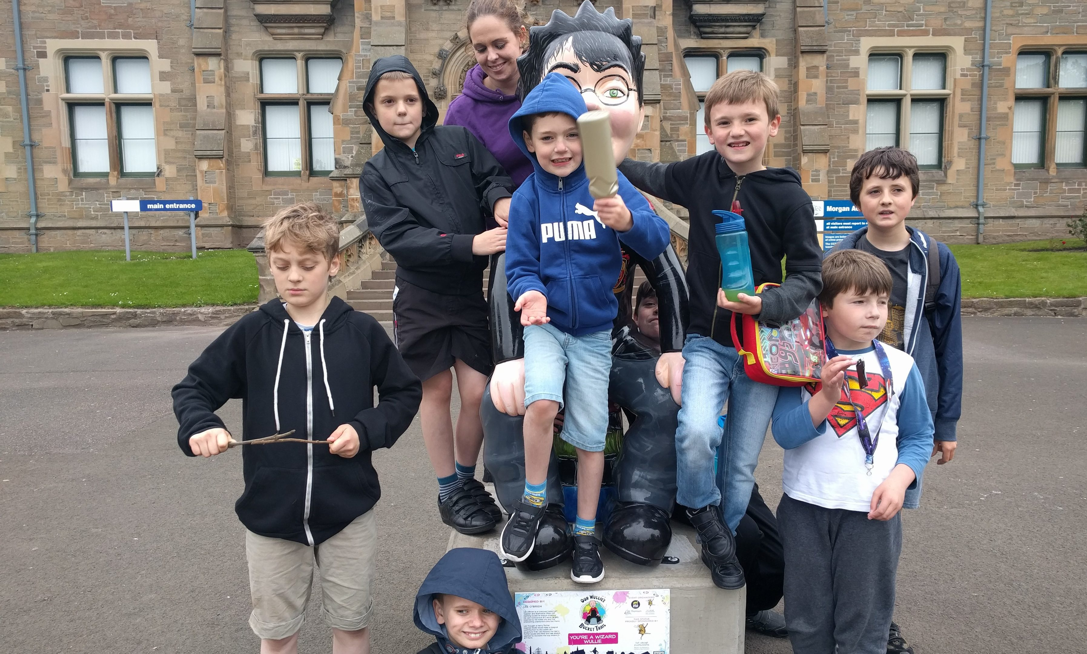 Youngsters looked after by the Spectrum charity enjoy a visit to the Harry Potter Oor Wullie statue that was in the grounds of Morgan Academy.