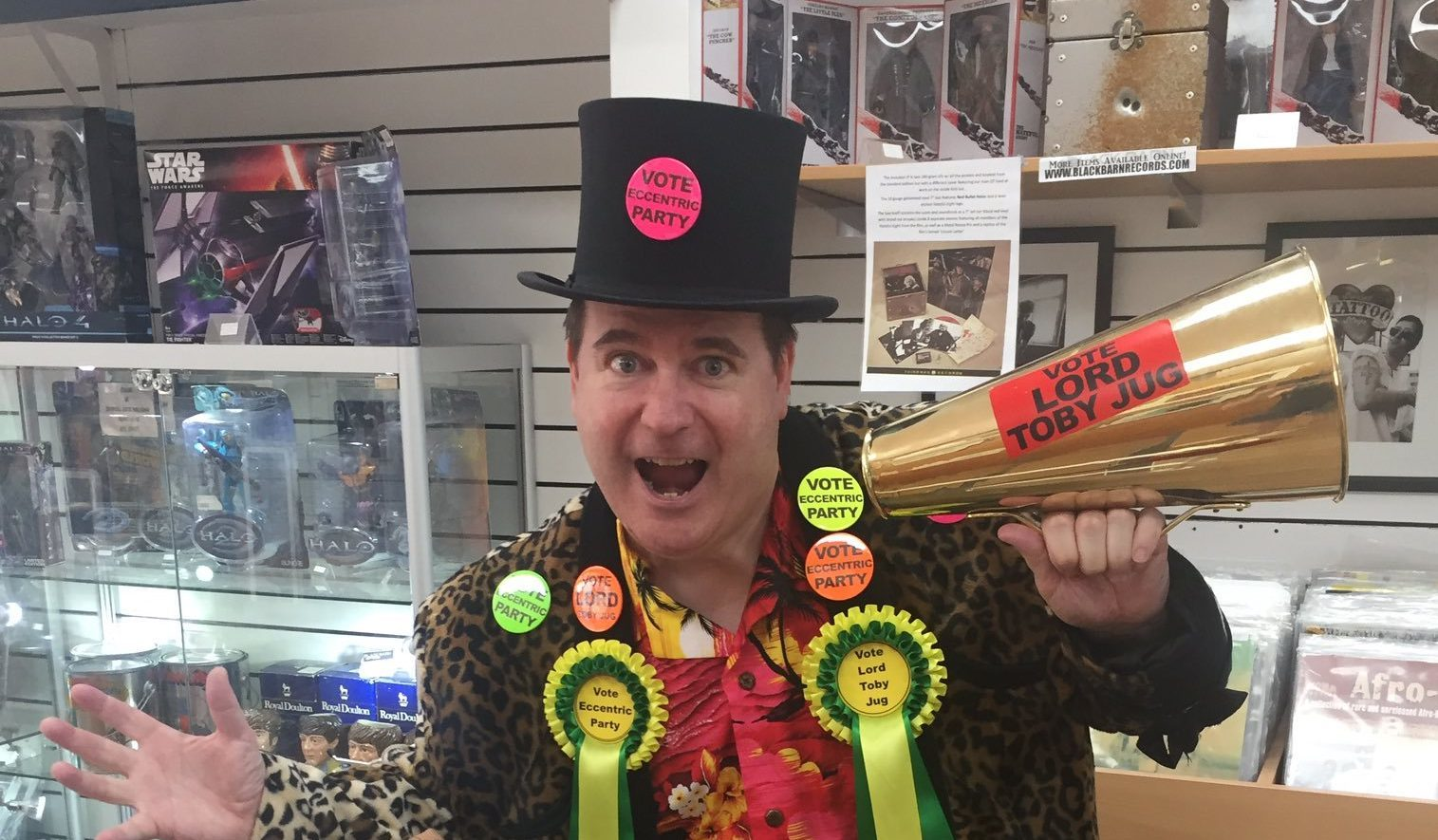 Lord Toby Jug of the Eccentric Party of Great Britain posing at Euromillions winner Adrian Bayford's shop