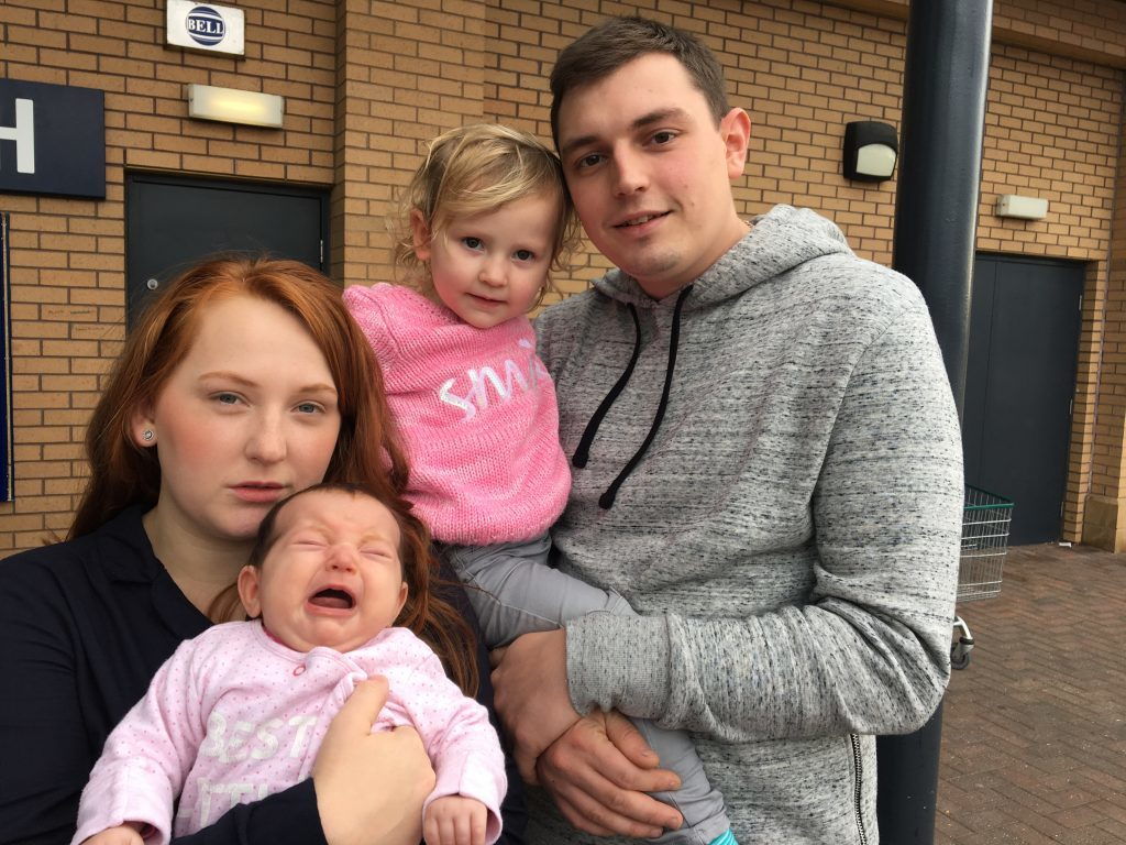 Mum-of-two Chelsea Crook, 24, and her husband Sam, 26, a bus mechanic, of Stockport, Greater Manchester, with their children Abigail, 2, and Hannah, 9 weeks.