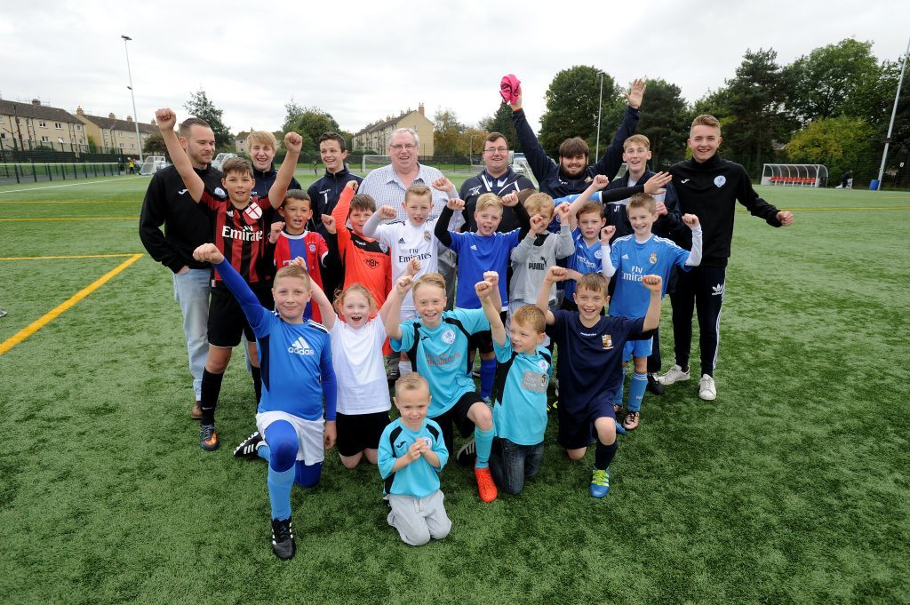Ken in the midst of youngsters and community coaches on the Seven Acres 3G pitches he helped make a reality.