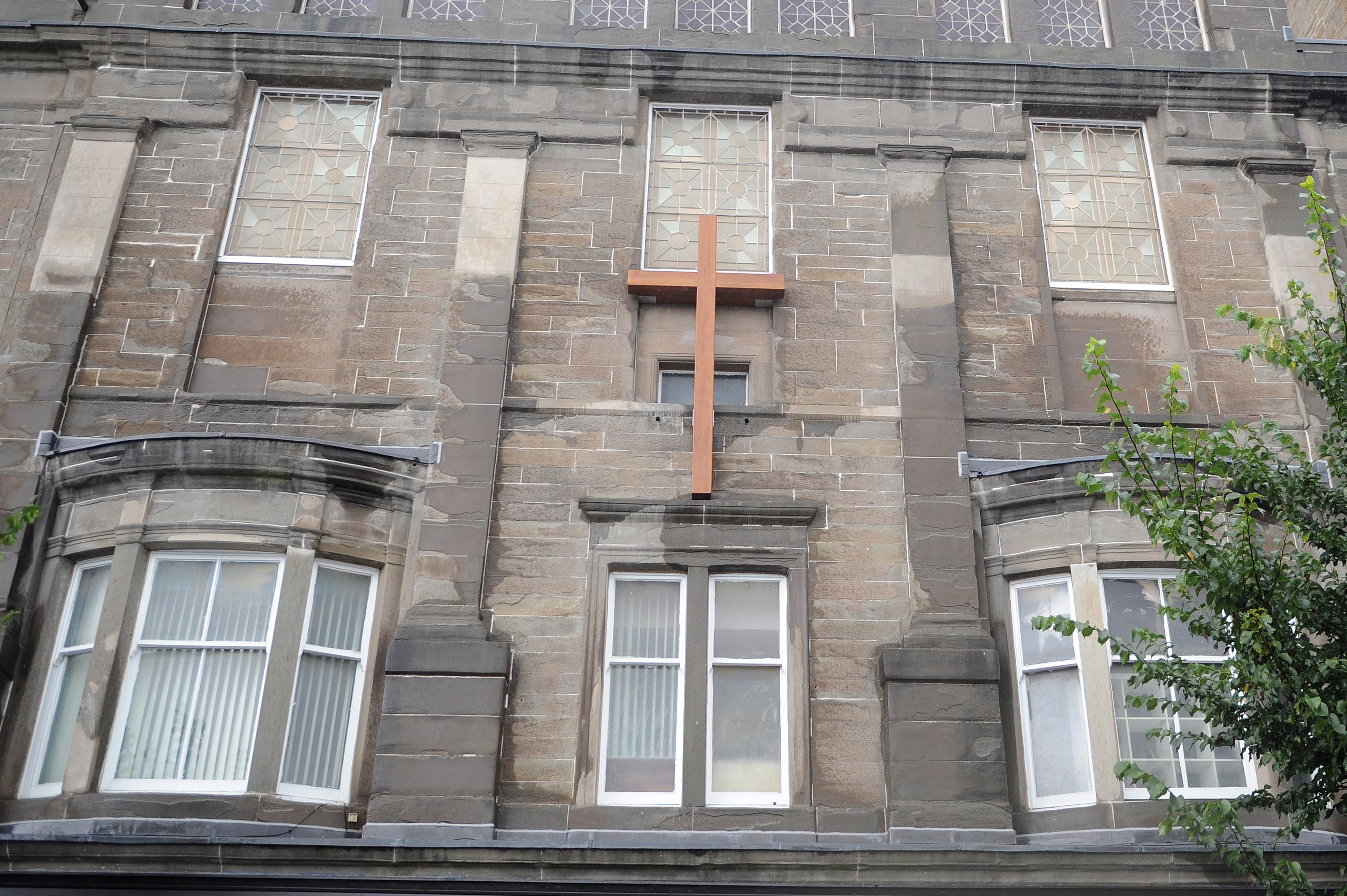 The giant cross on Gilfillan Memorial Church was taken down in November but is expected to be re-installed this week.