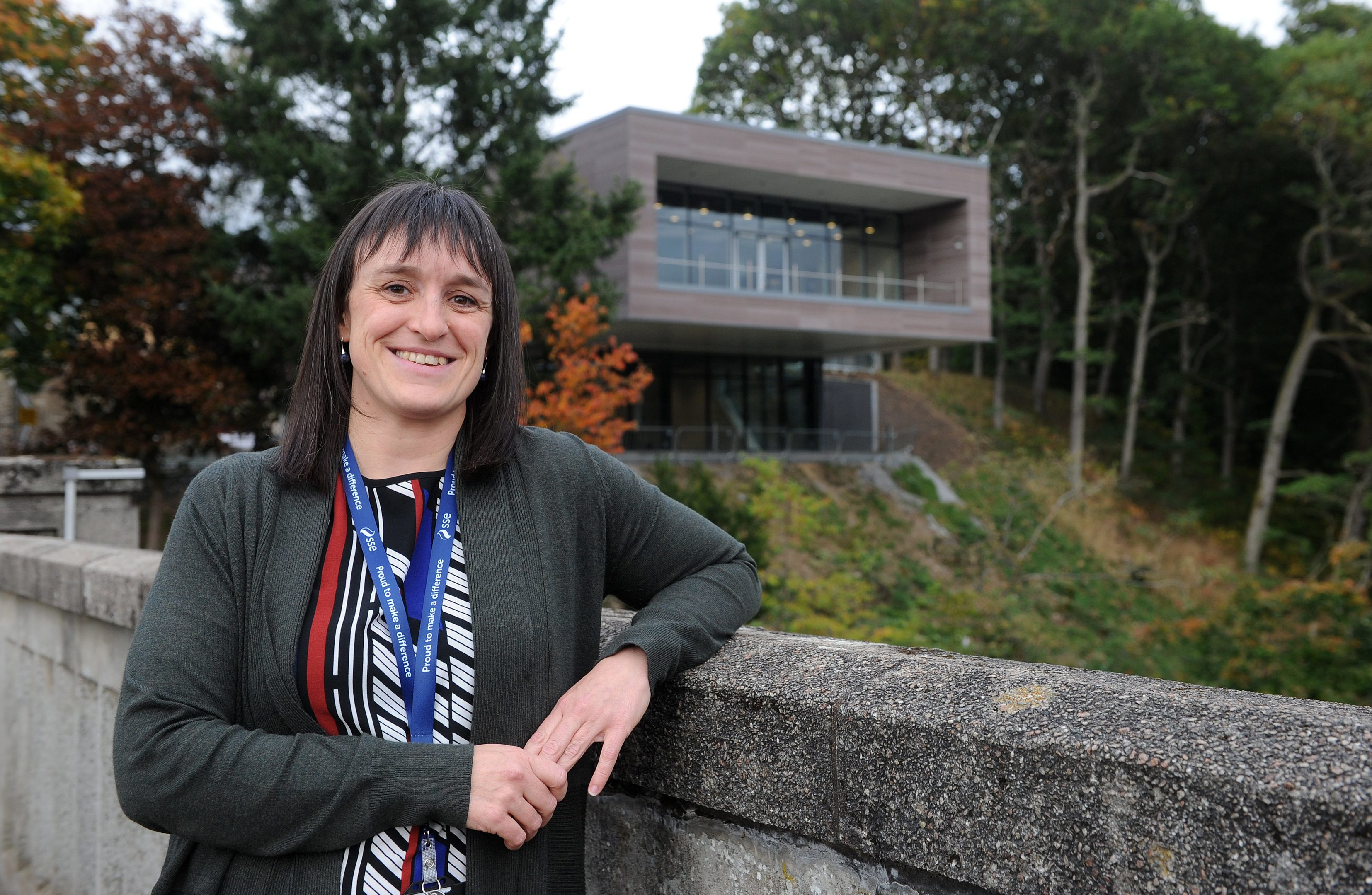 Lisa Daniels (Visitor Centre Manager) with the new centre in the background at Pitlochry dam.