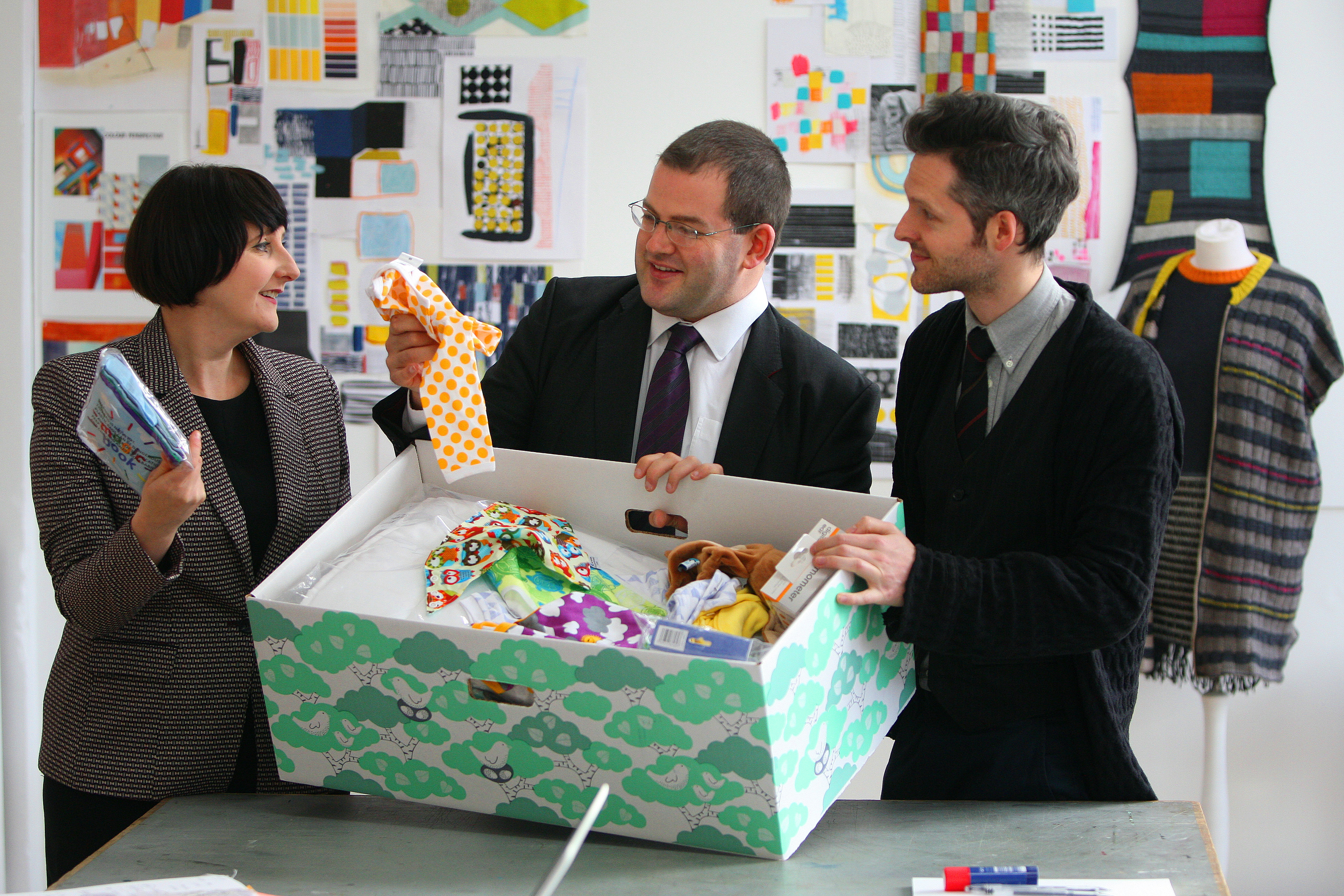 Mark McDonald MSP discusses the content of the boxes with Sarah Saunders and Scott Jarvie