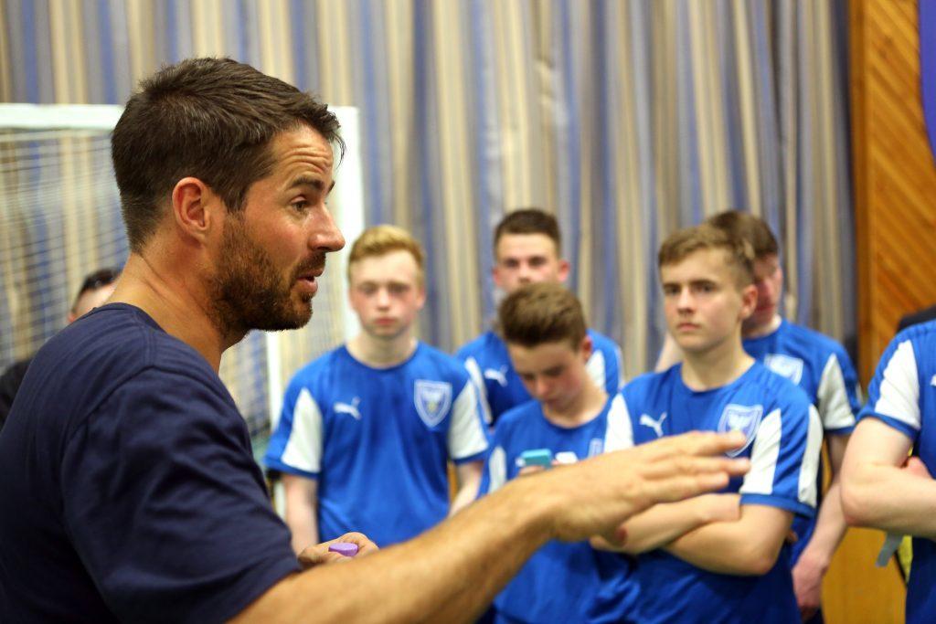 Redknapp talks tactics with the senior champions team at St John's RC