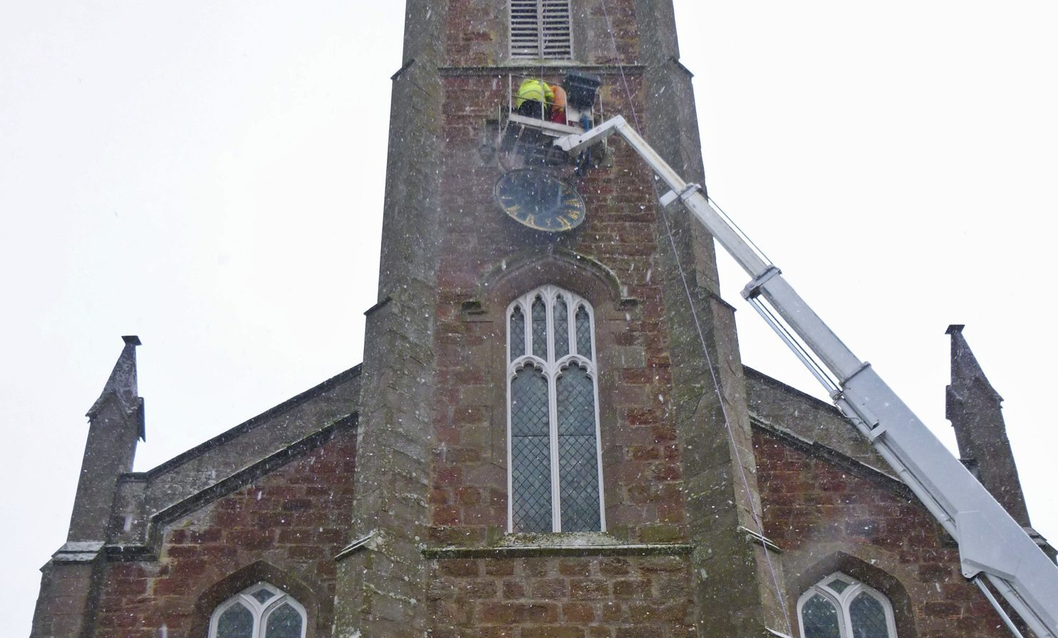 The clock undergoing maintenance.