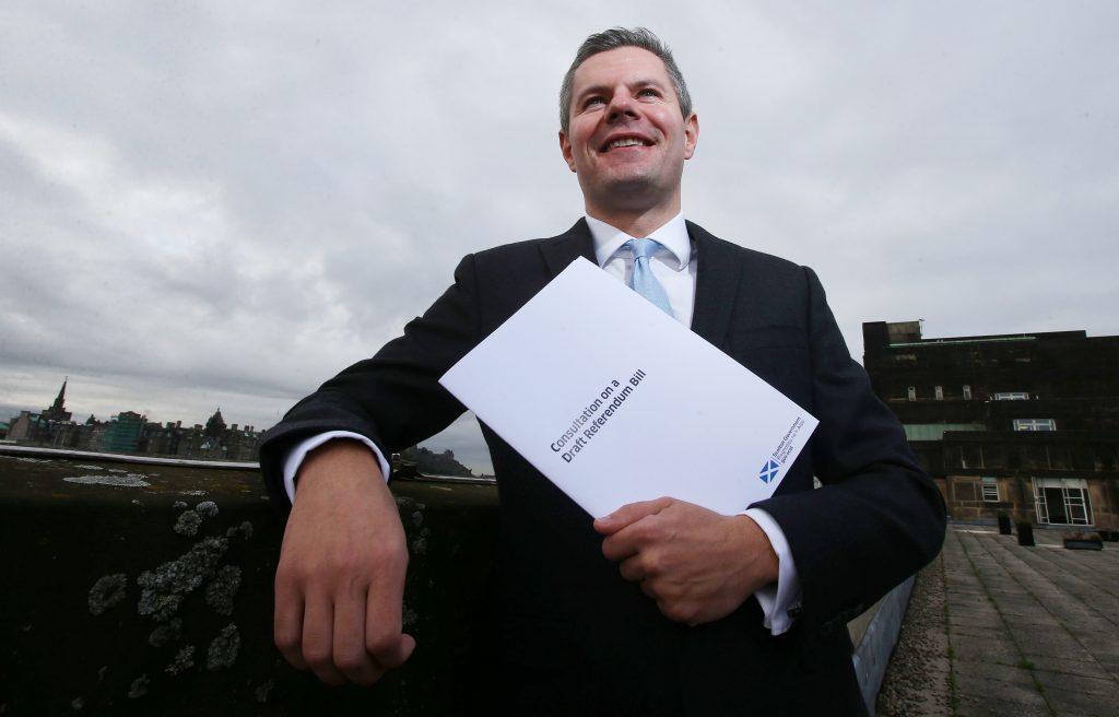 Constitution Minister Derek Mackay holds a copy of the Draft Referendum Bill.
