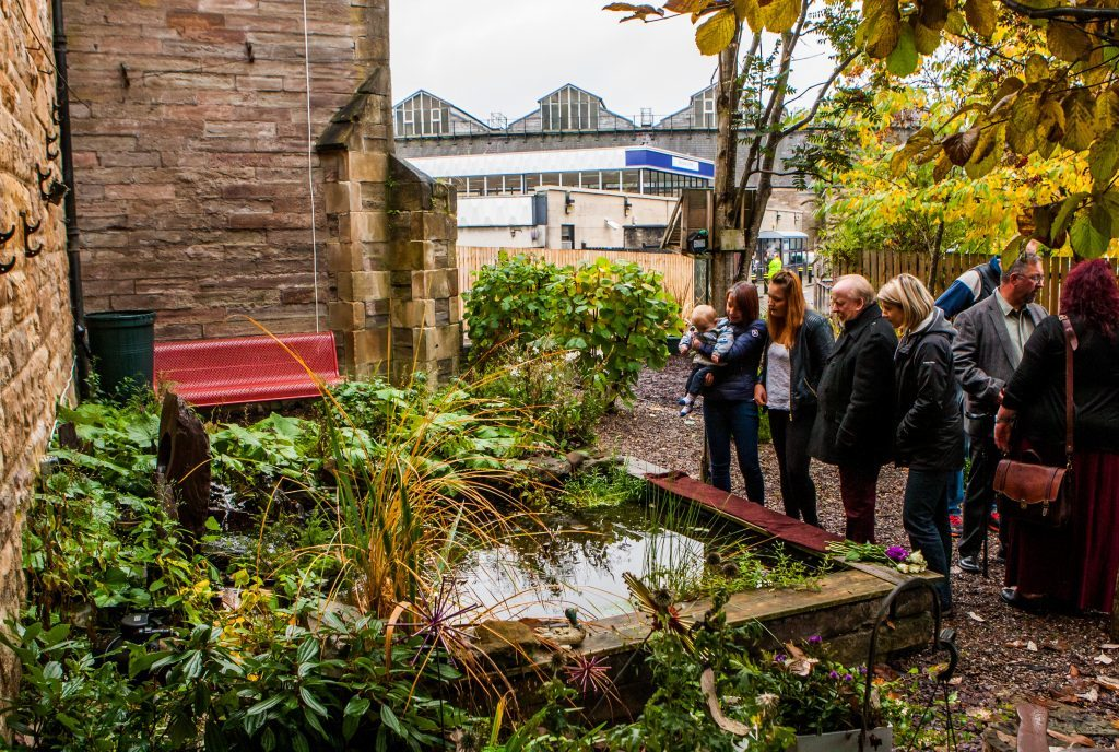 A memorial to David Haines is unveiled by family and former colleagues at Perth railway station.