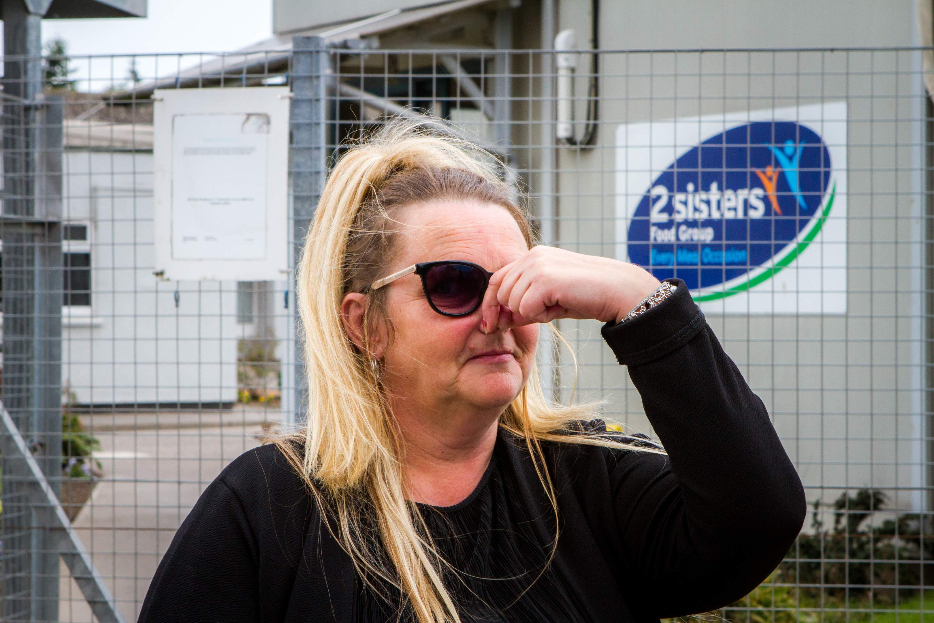 Fed up — local resident Mary-Anne Lochrane is pictured outside the 2 Sisters Food Group factory.
