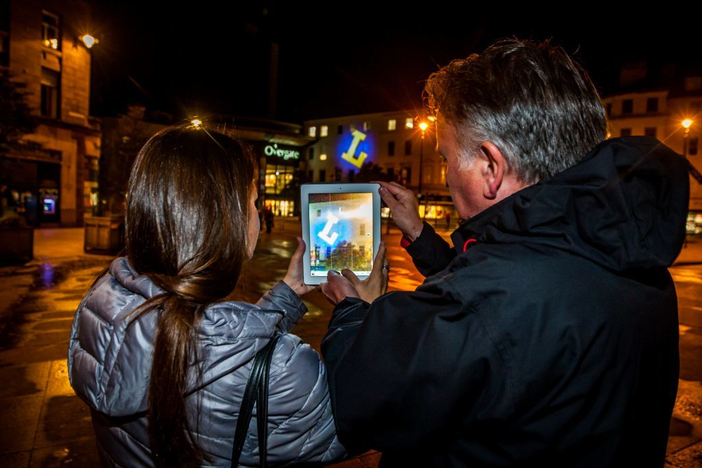Gary Gowans (programme director of graphic design, DJCAD) and wife Morag Muir visiting the city square to view Gary's projections.
