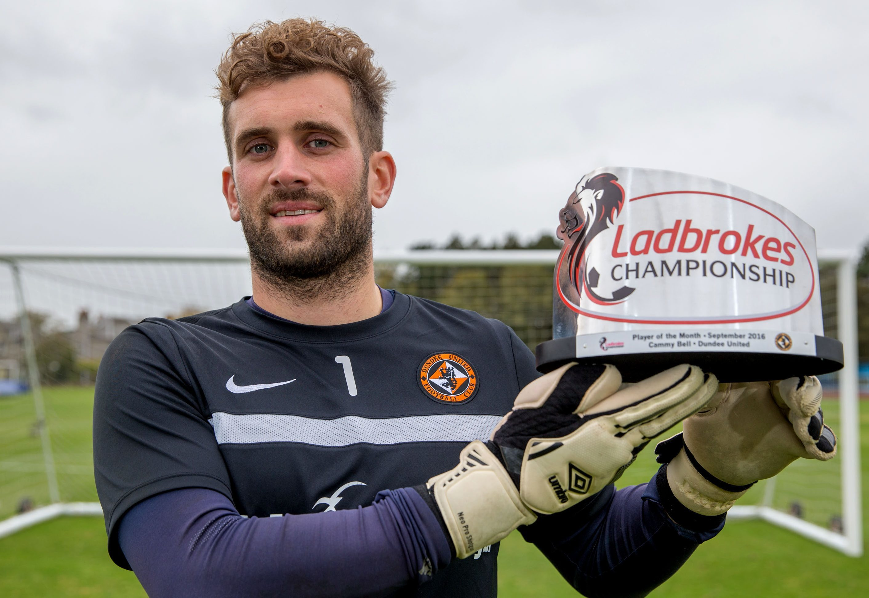 Cammy Bell with his award.