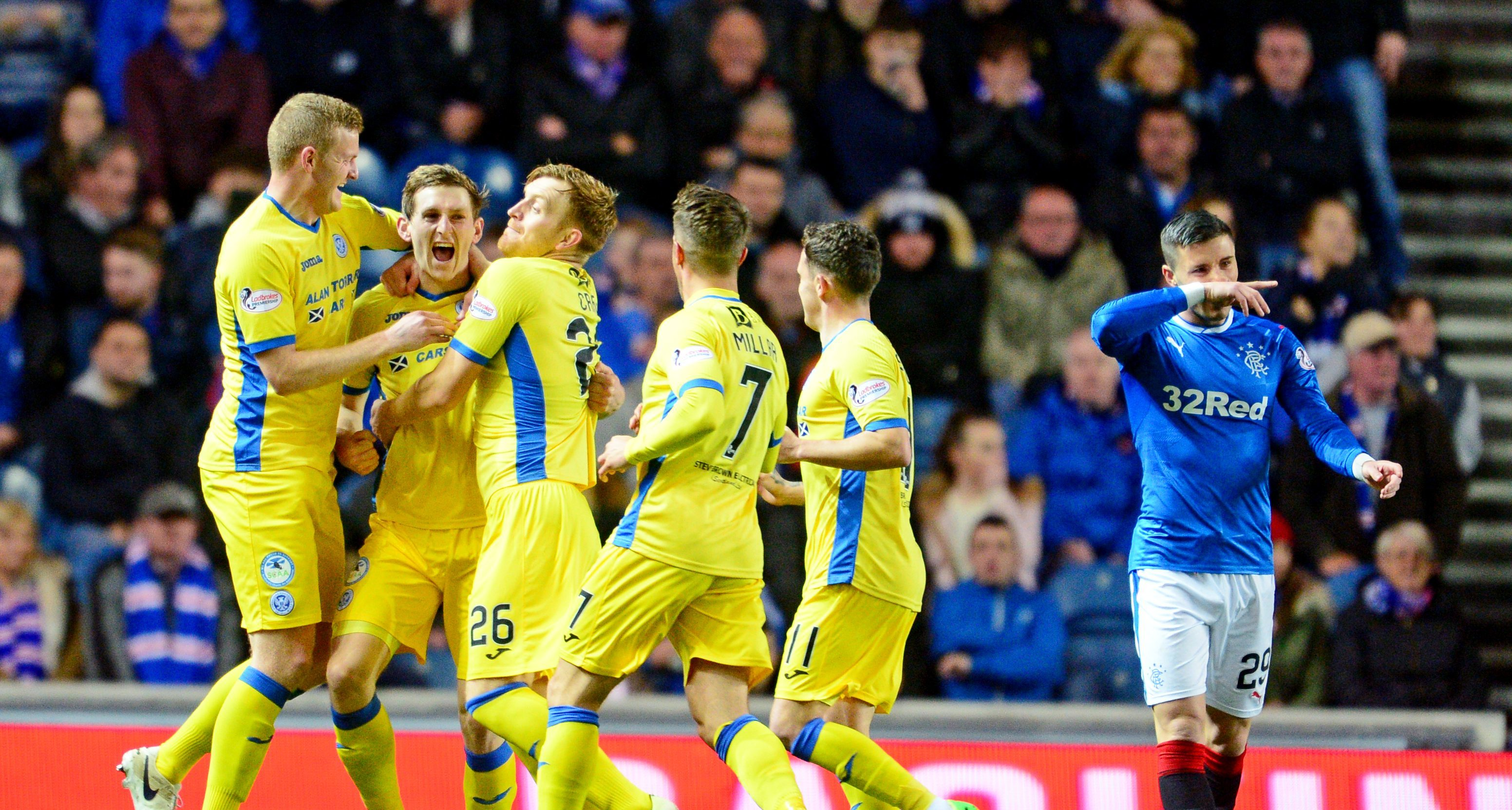 The St Johnstone players celebrate after Blair Alston scored his stunning goal at Ibrox.