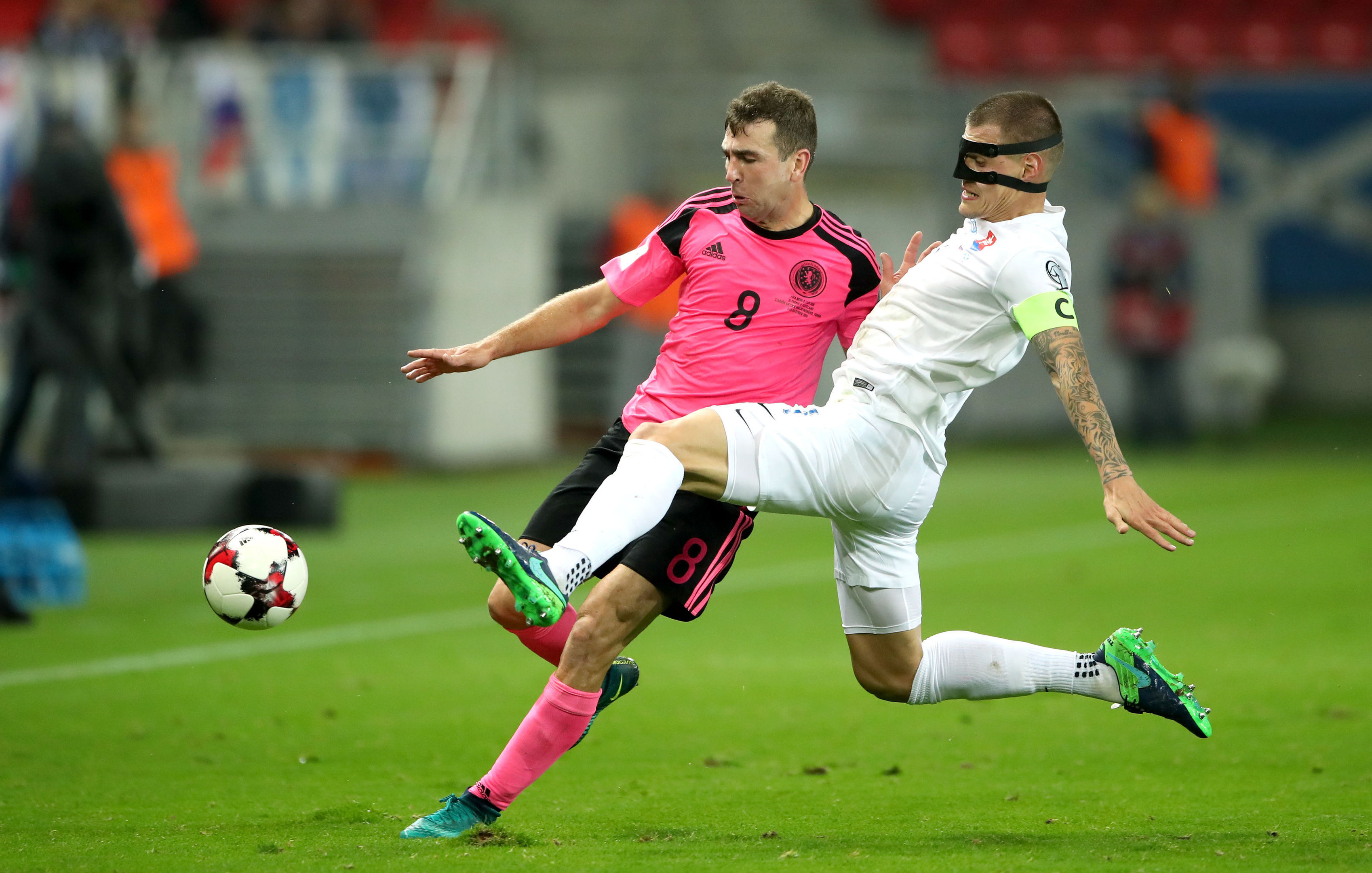 James McArthur and Slovakia's Martin Skrtel battle for the ball.