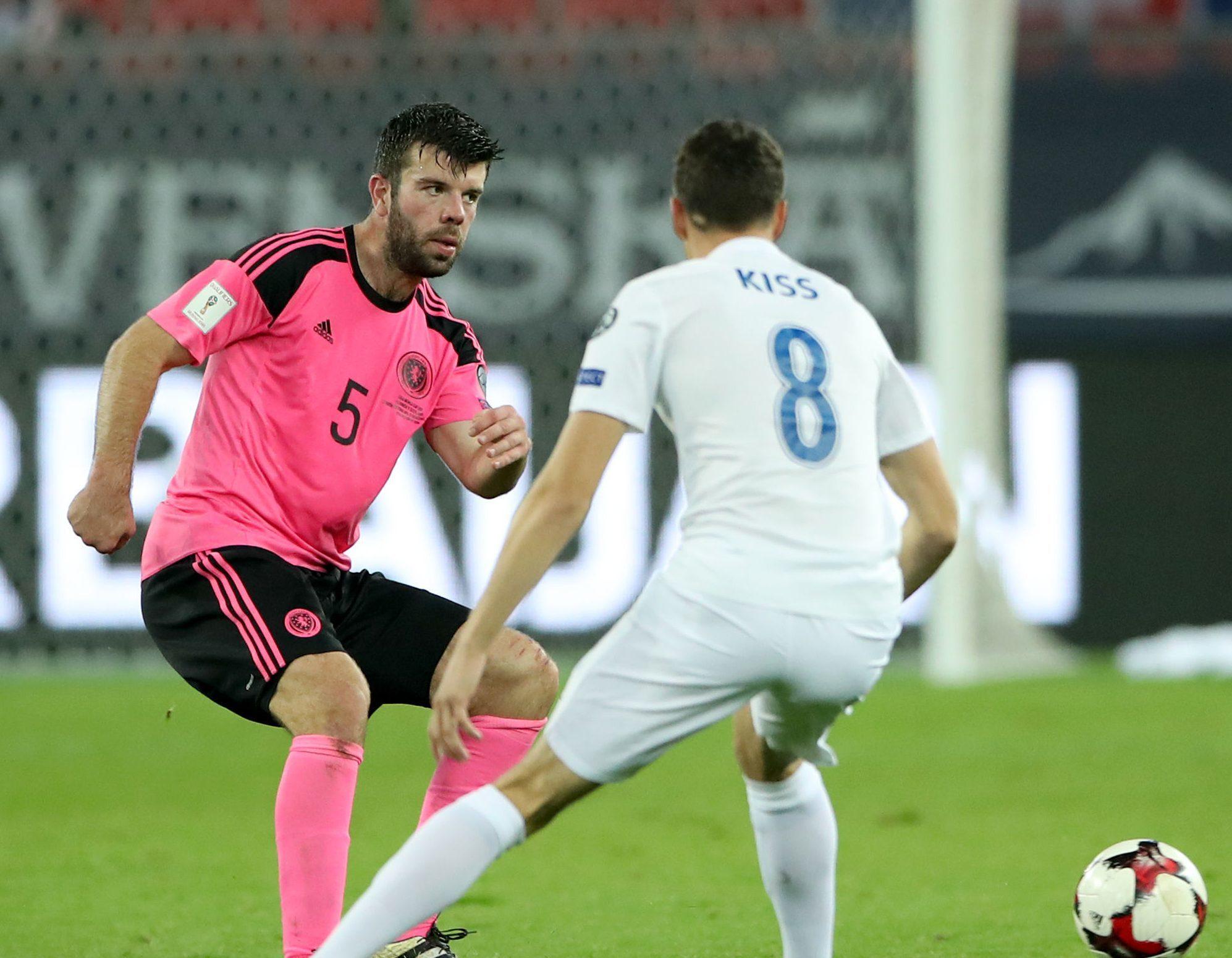 Grant Hanley battles for the ball in Slovakia.