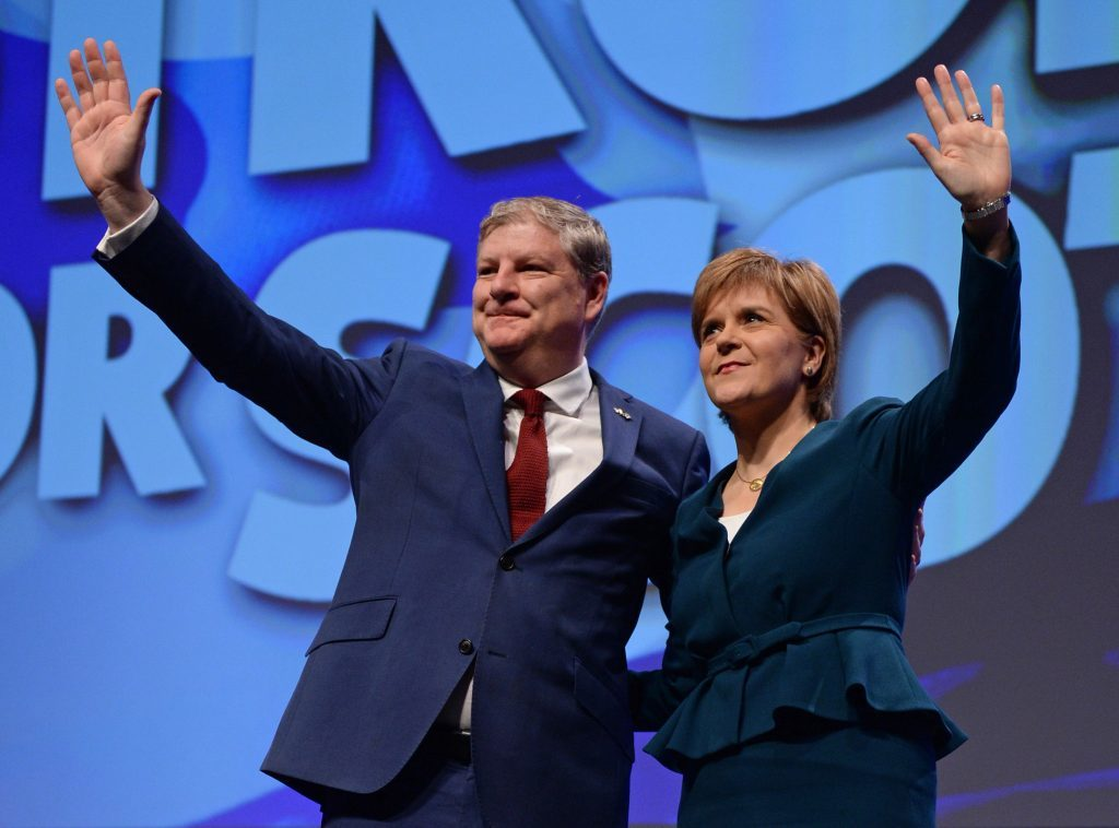 Scottish First Minister Nicola Sturgeon and new SNP deputy leader Angus Roberston, addressing the SNP Autumn Conference in Glasgow SECC, where she warned against the dangers of hard Brexit.