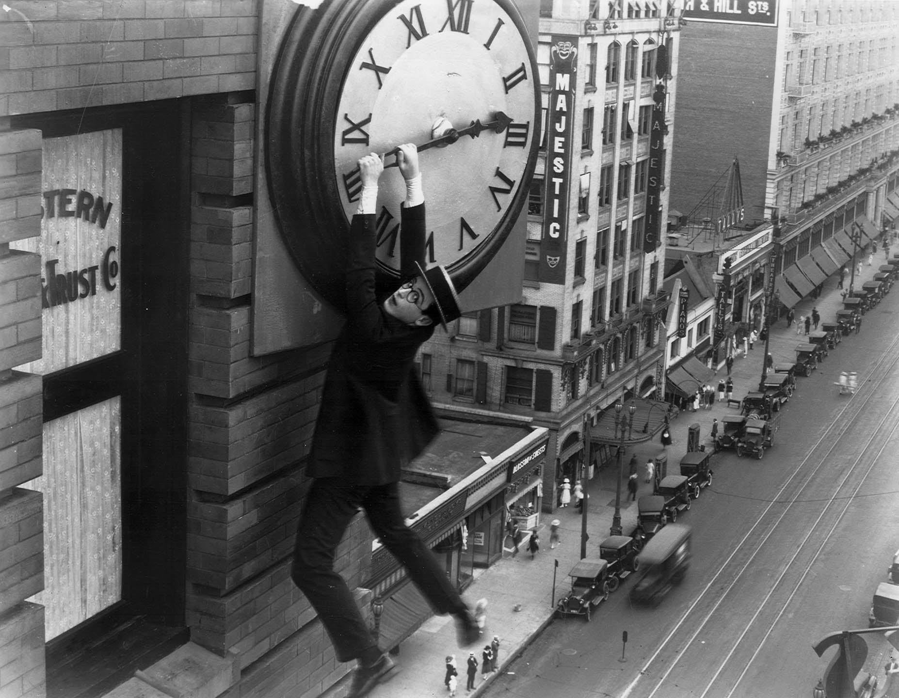 Harold Lloyd hangs from a clock in Safety Last
