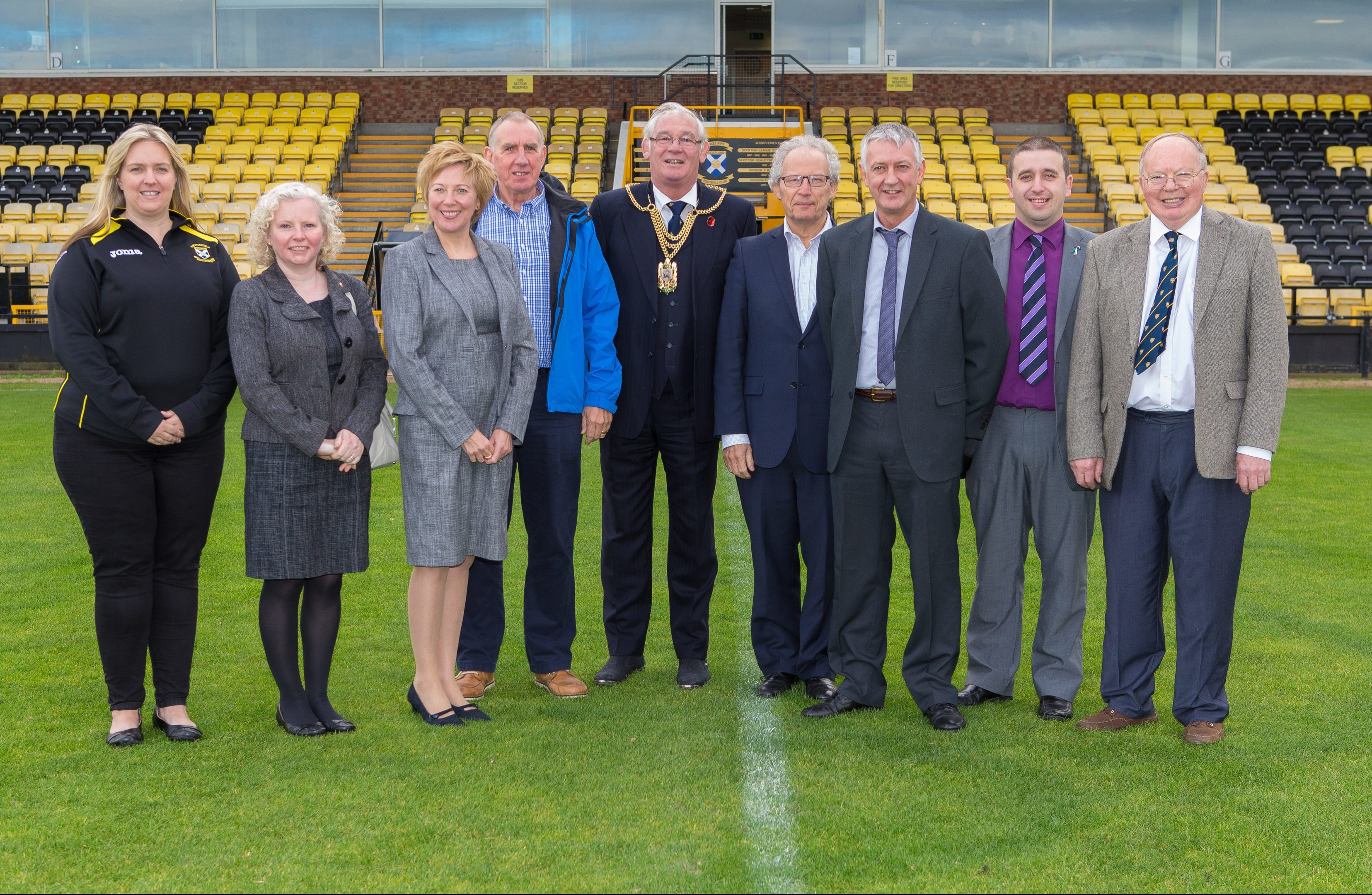 From left Lorna McCauley (Youth Academy), Councillor Claire Baker, Councillor Lesley Laird, Allan Duffy, Provost Jim Leishman, MSP Henry McLeish, Councillor David Graeme, Andrew Hutchison (FFTC) at Bayview Football Club where the turf will be replaced with astroturf material due to funding from Fife Council.