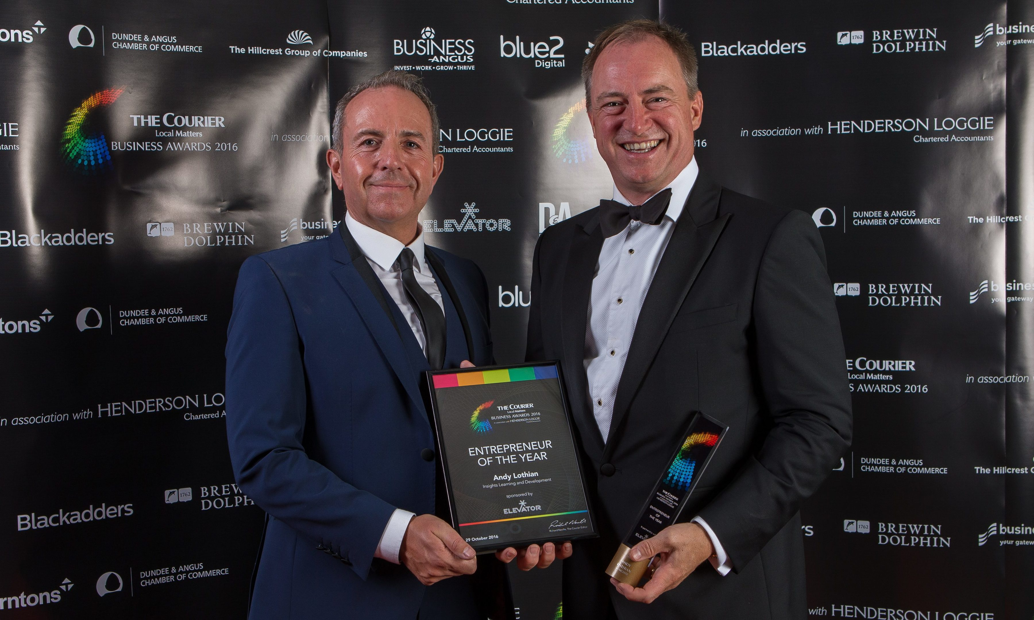 Andy Lothian (right) receiving the Entrepreneur of the Year prize at the 2016 Courier Business Awards from Professor Gary McEwan.
