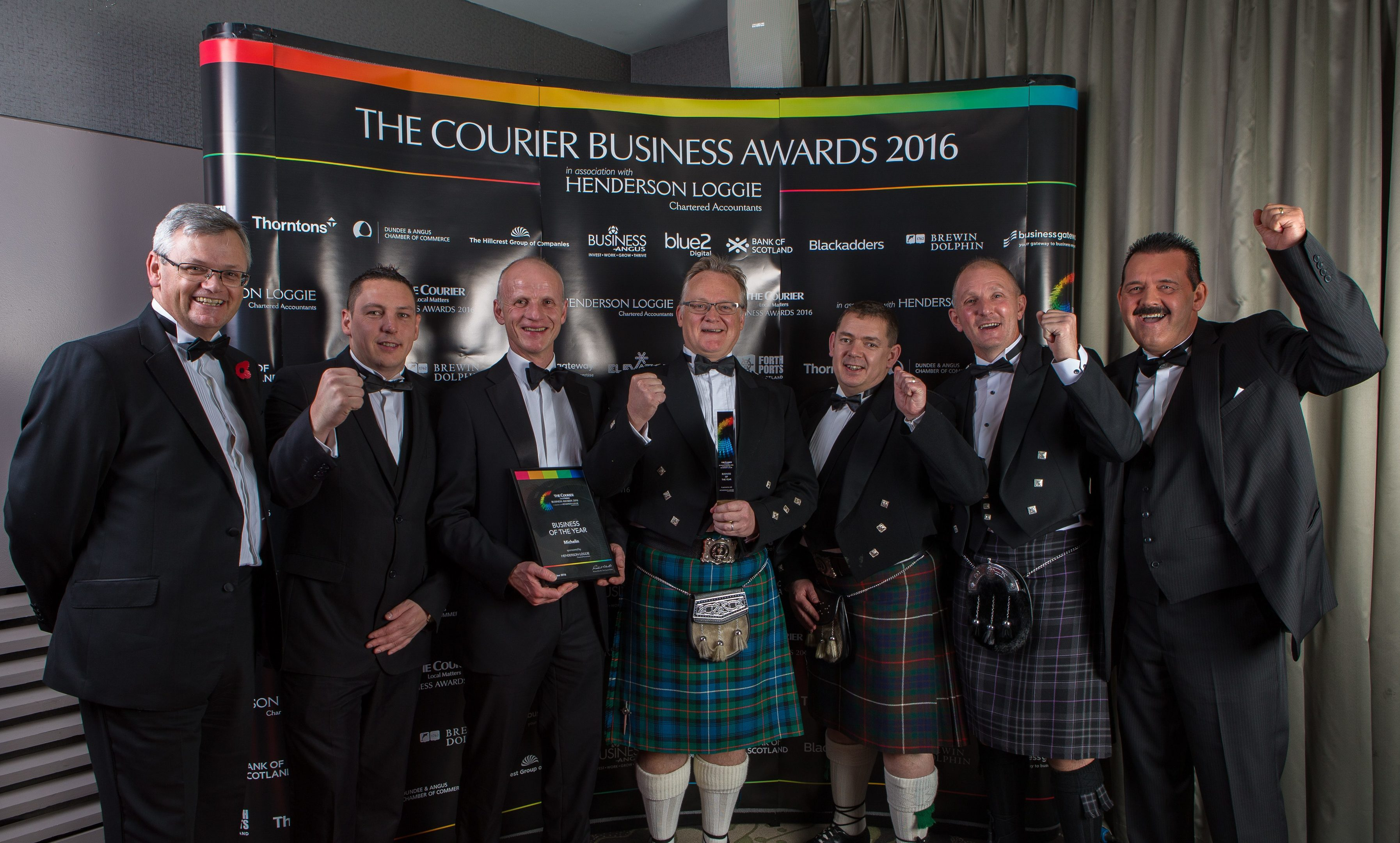 The Michelin team celebrate winning the Business of the Year award.